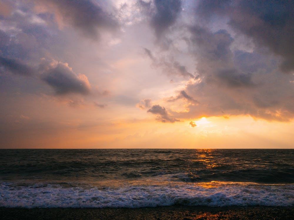 Gratis arkivbilde med bølger, gylden time, hav