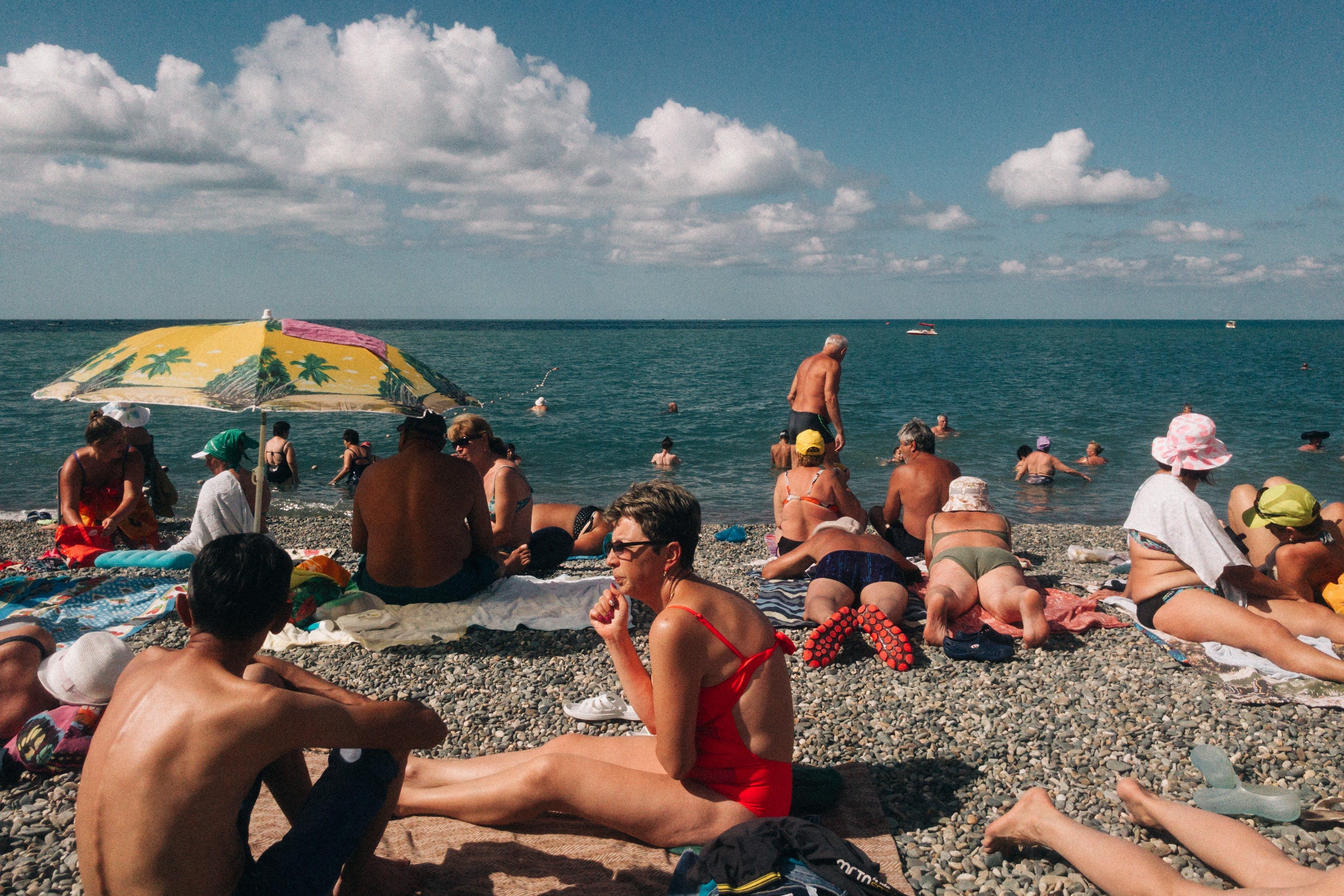 Crowd of People on Seashore Under Blue Sky