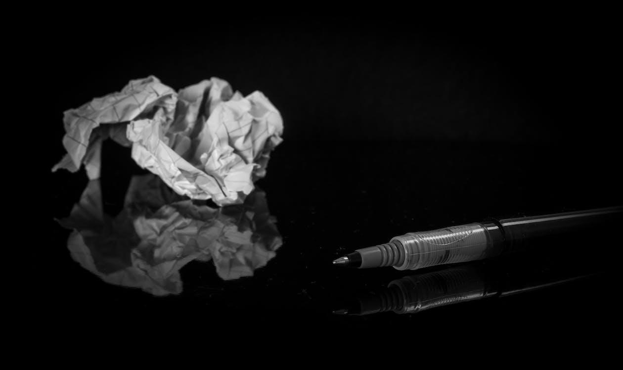 Black Pen Near White Printer Paper