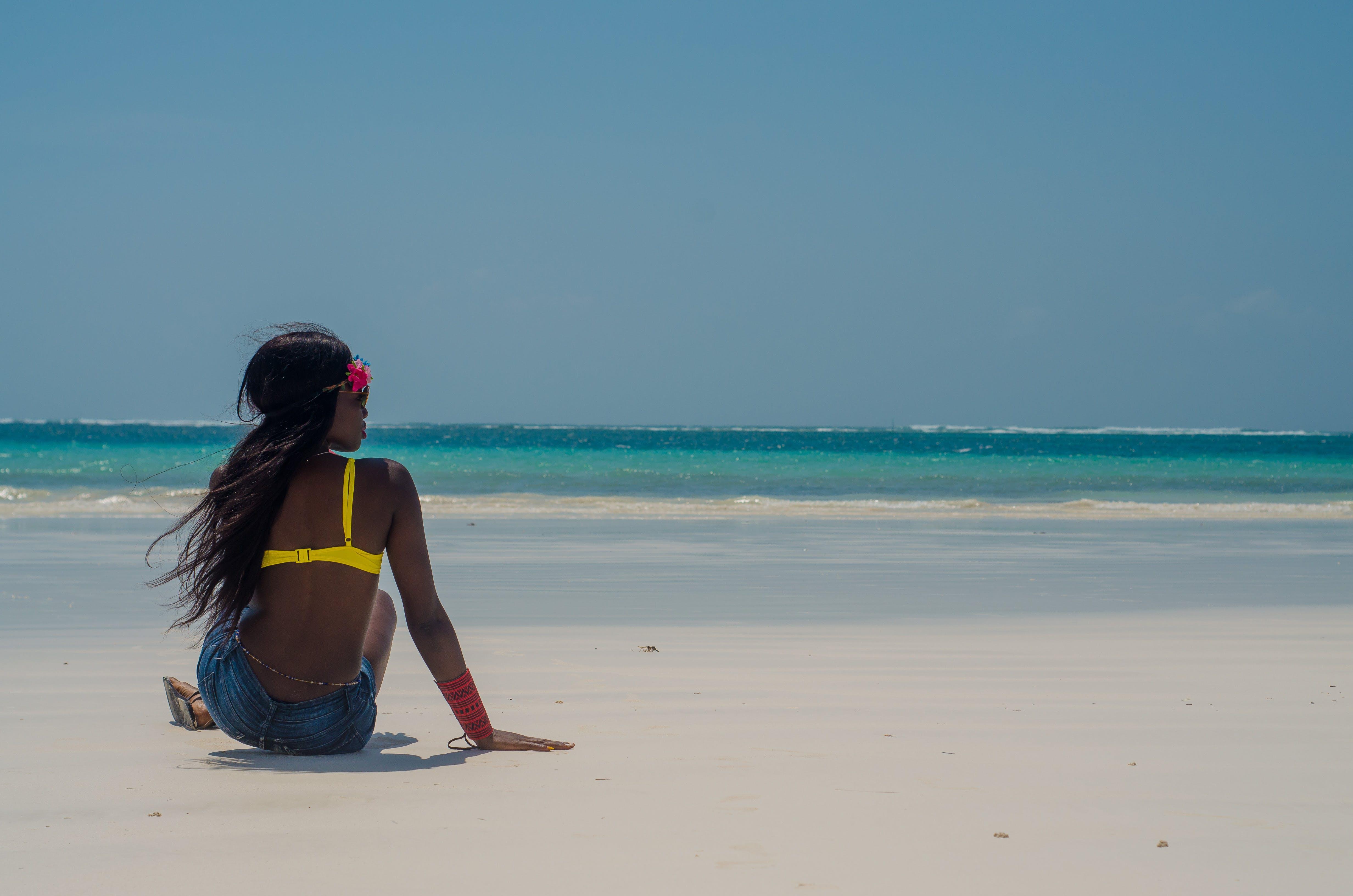 Photo of Woman Sitting on Seashore