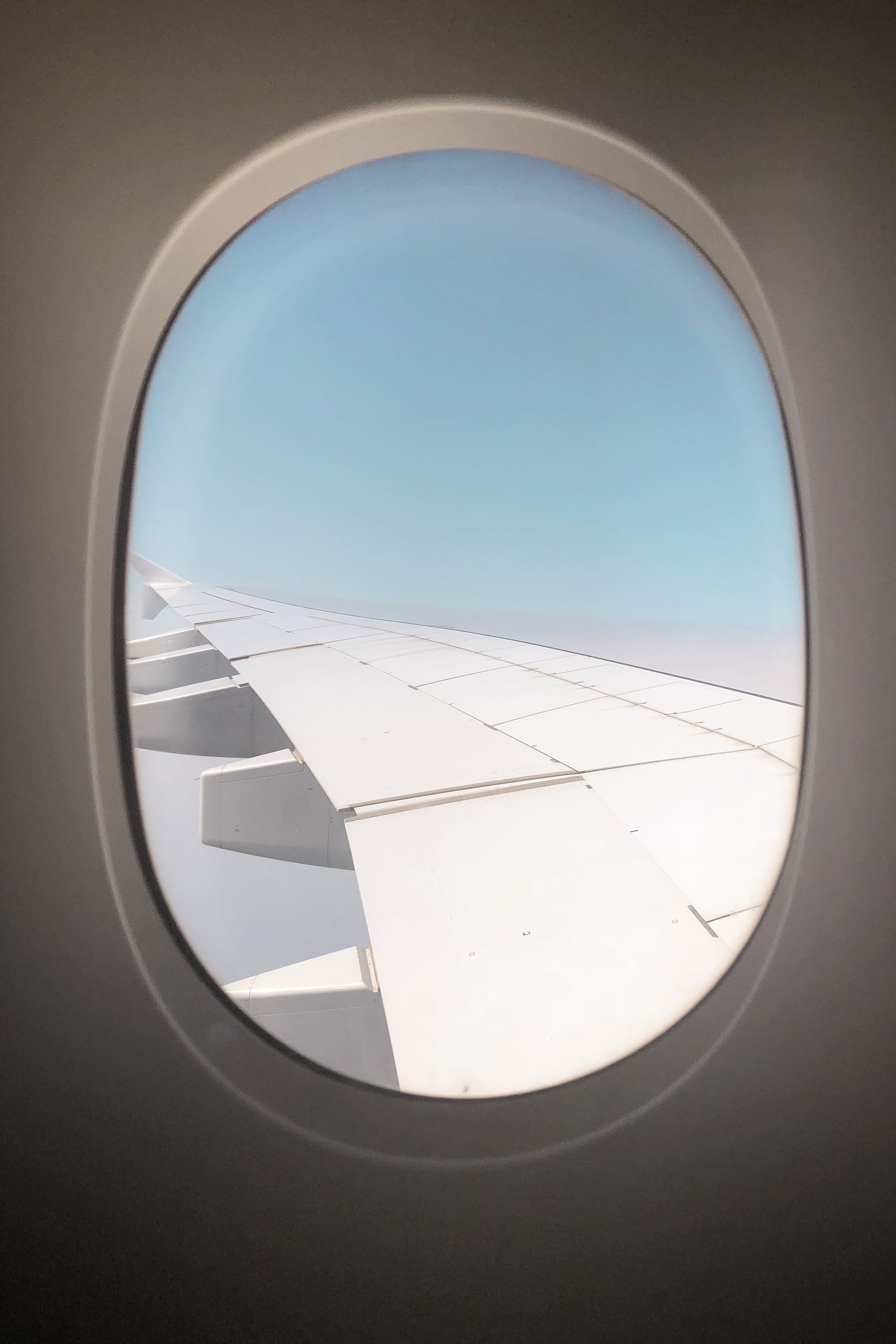 Window Showing Airplane Wing