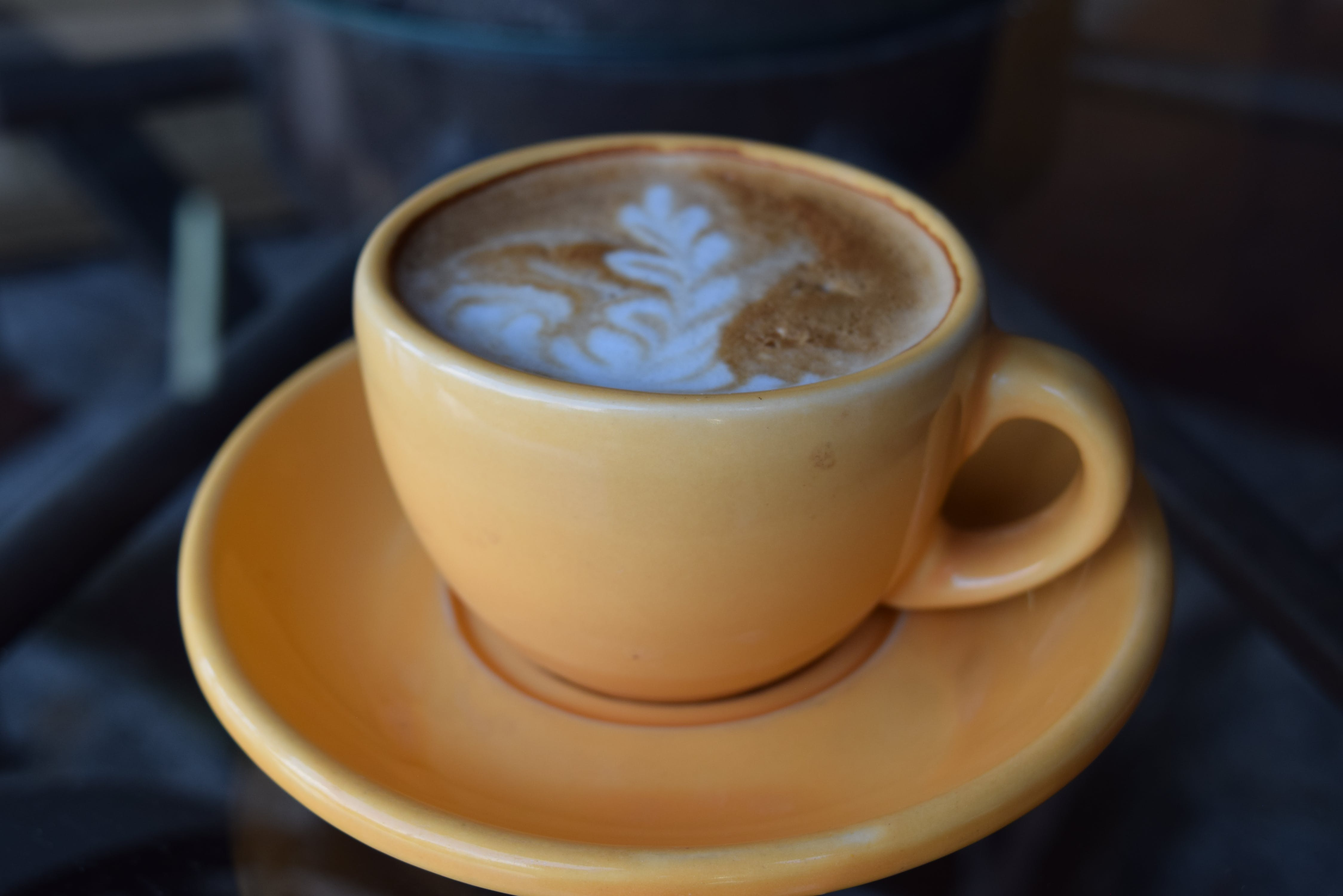 Coffee Latte on Brown Ceramic Cup and Platter