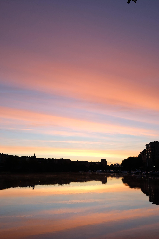 Kostenloses Stock Foto zu sonnenaufgang, stockholm, wasser