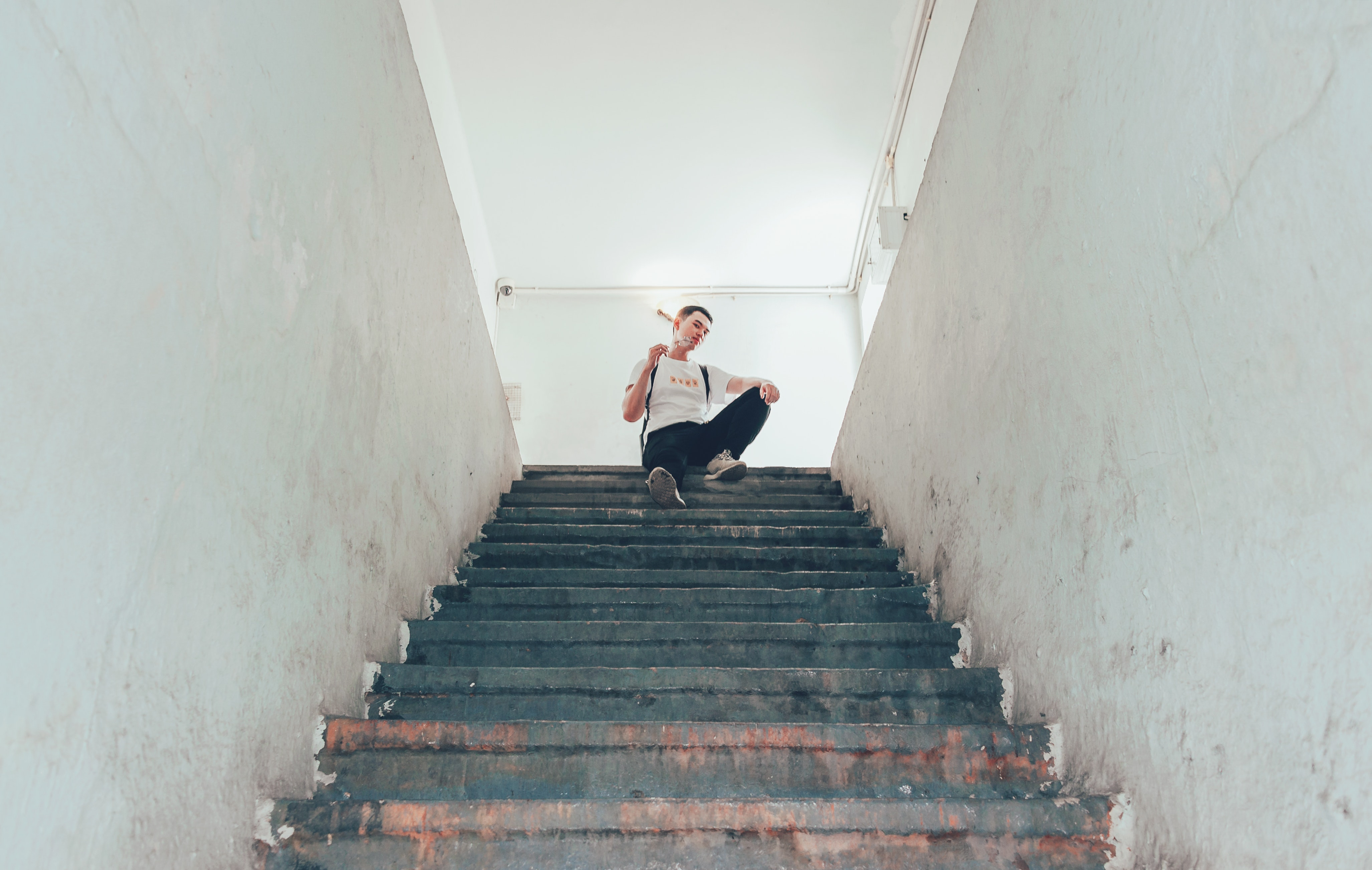 Image result for man at top of stairs