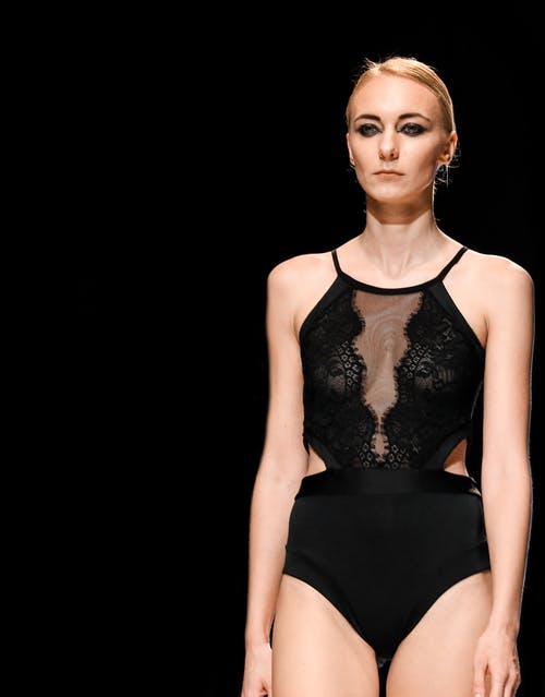Photo of Runway Model Wearing Black One-piece Suit