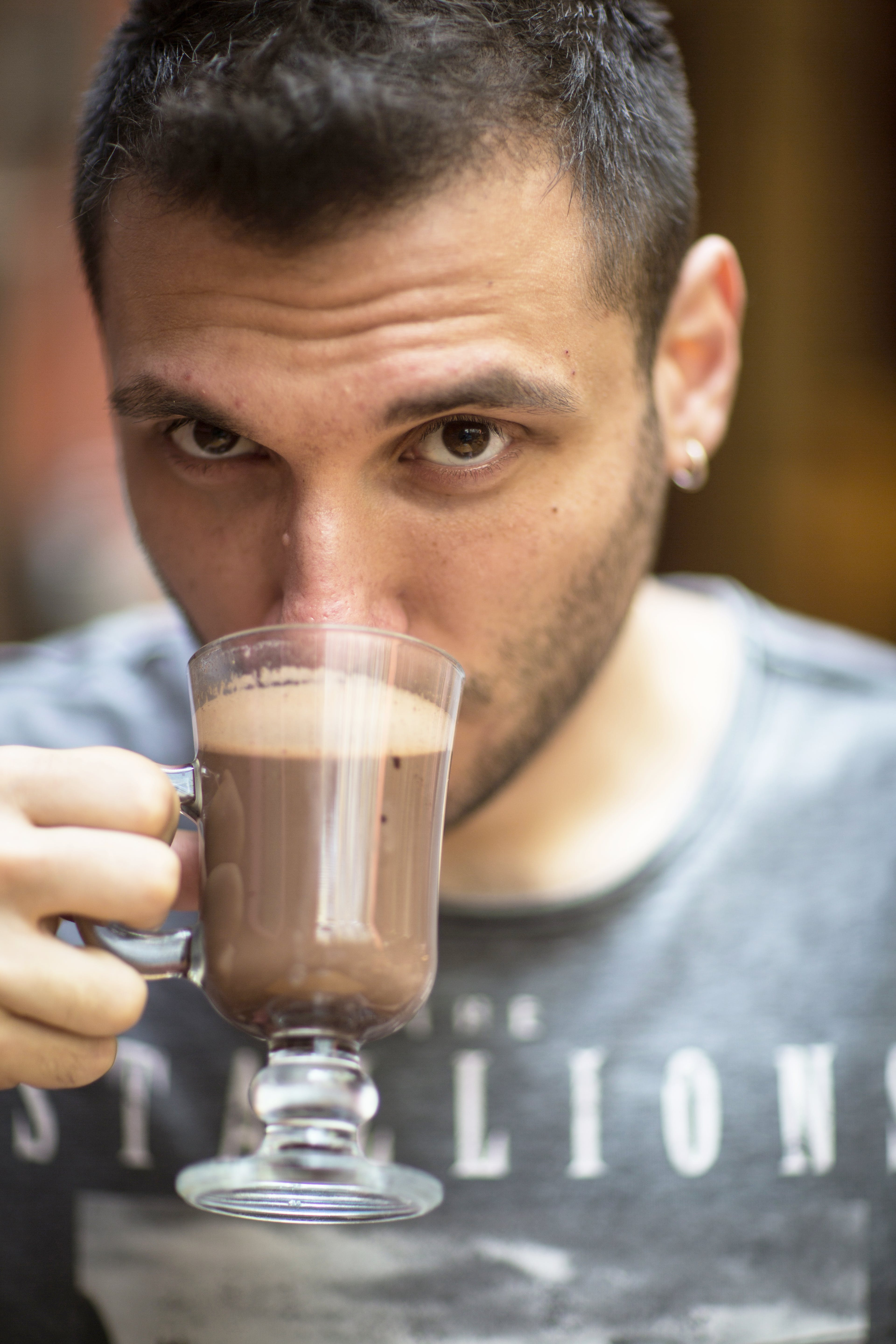 Man Sipping Chocolate Drink