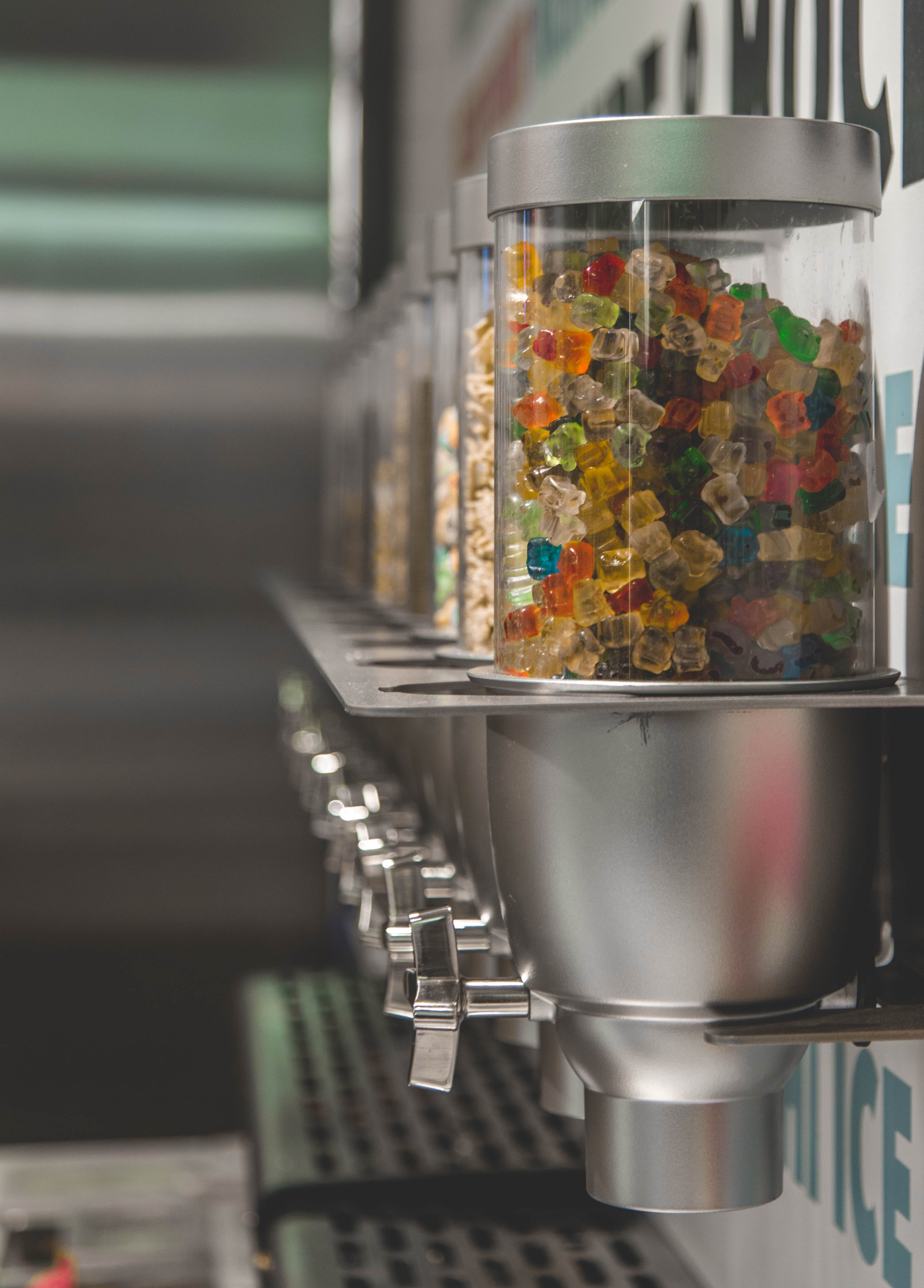 Selective Focus Photography of Candy Dispenser