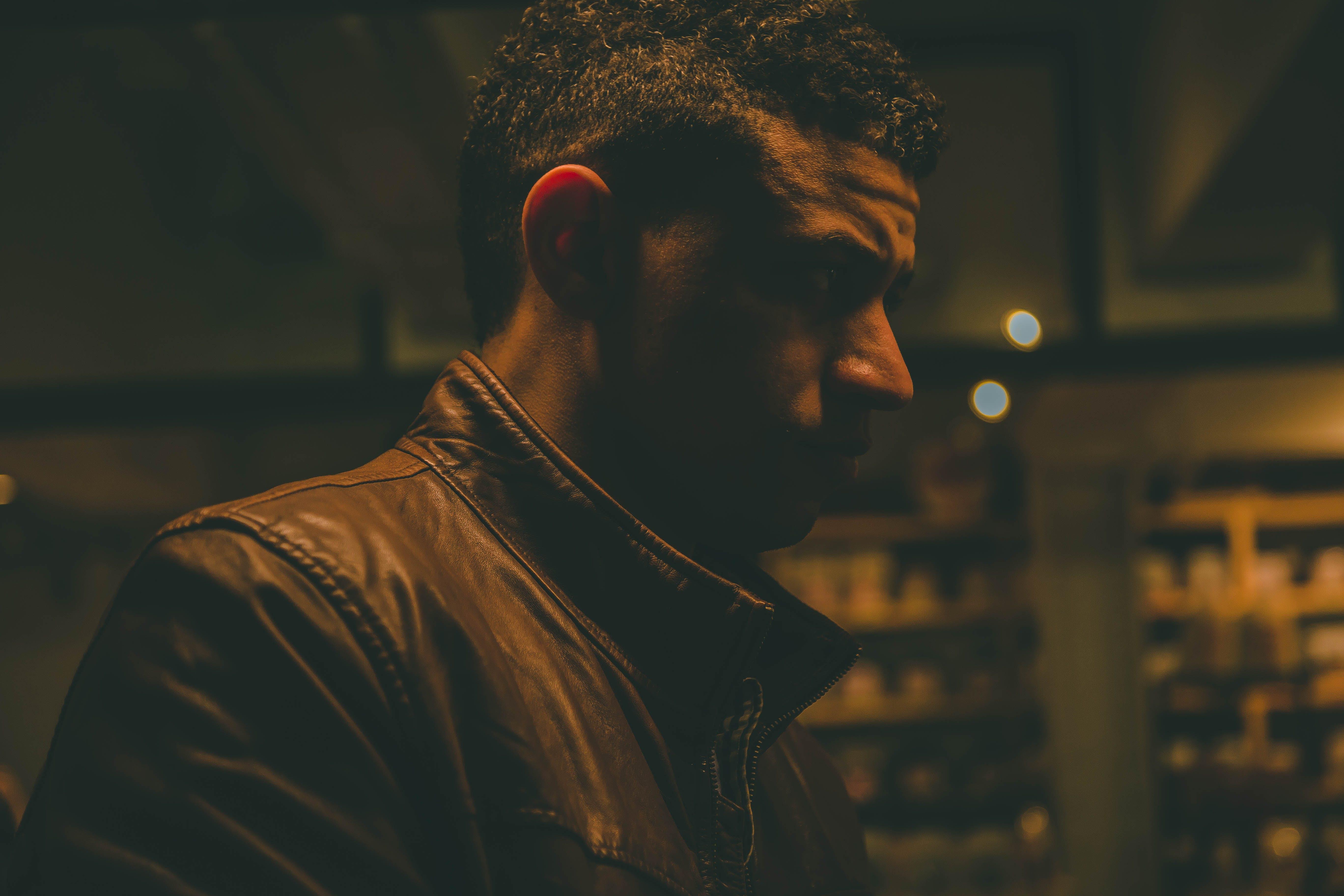 Close-Up Photo of Man Wearing Leather Jacket