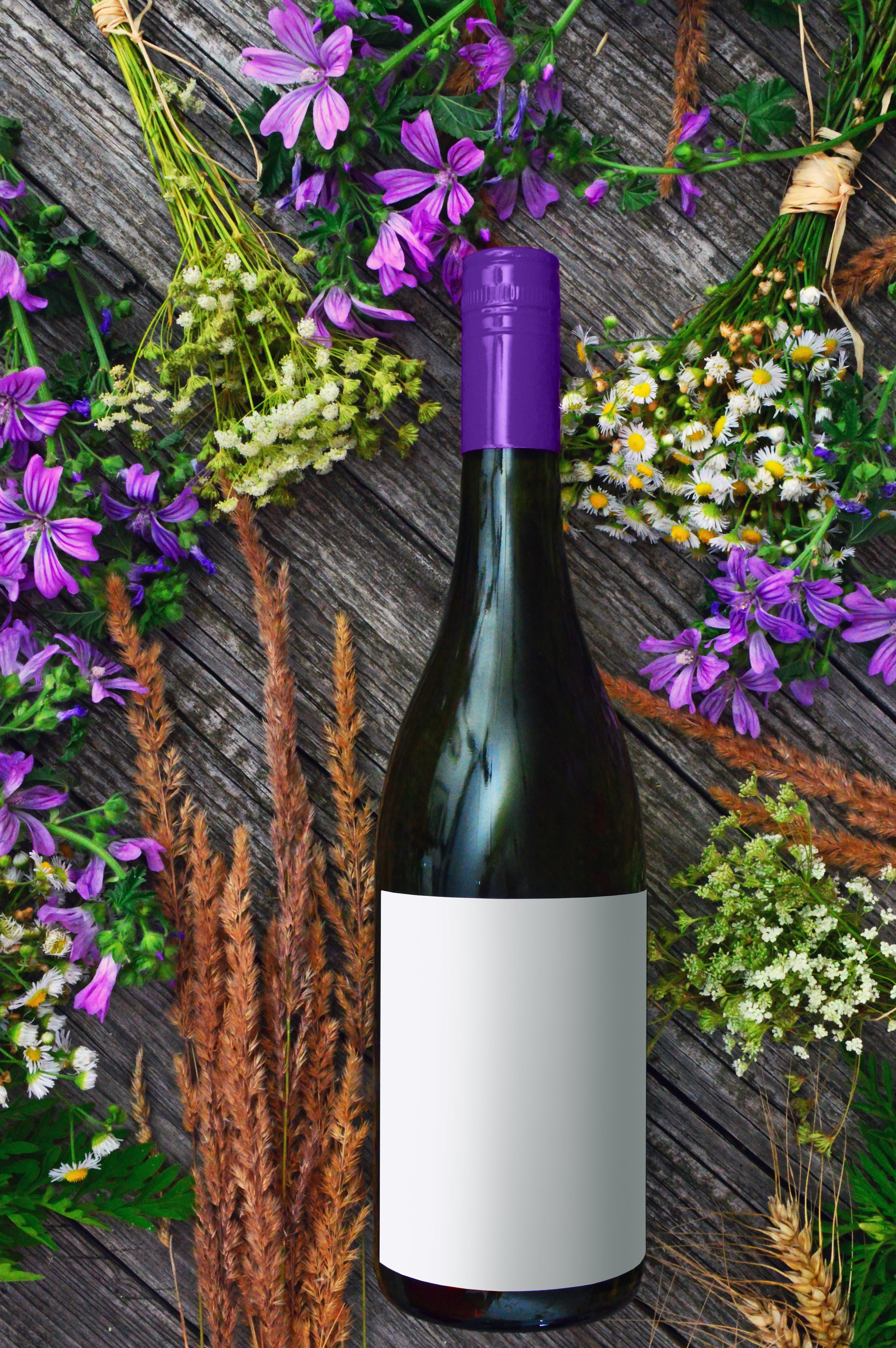 Photo Of Wine Bottles Near Flowers Free Stock Photo