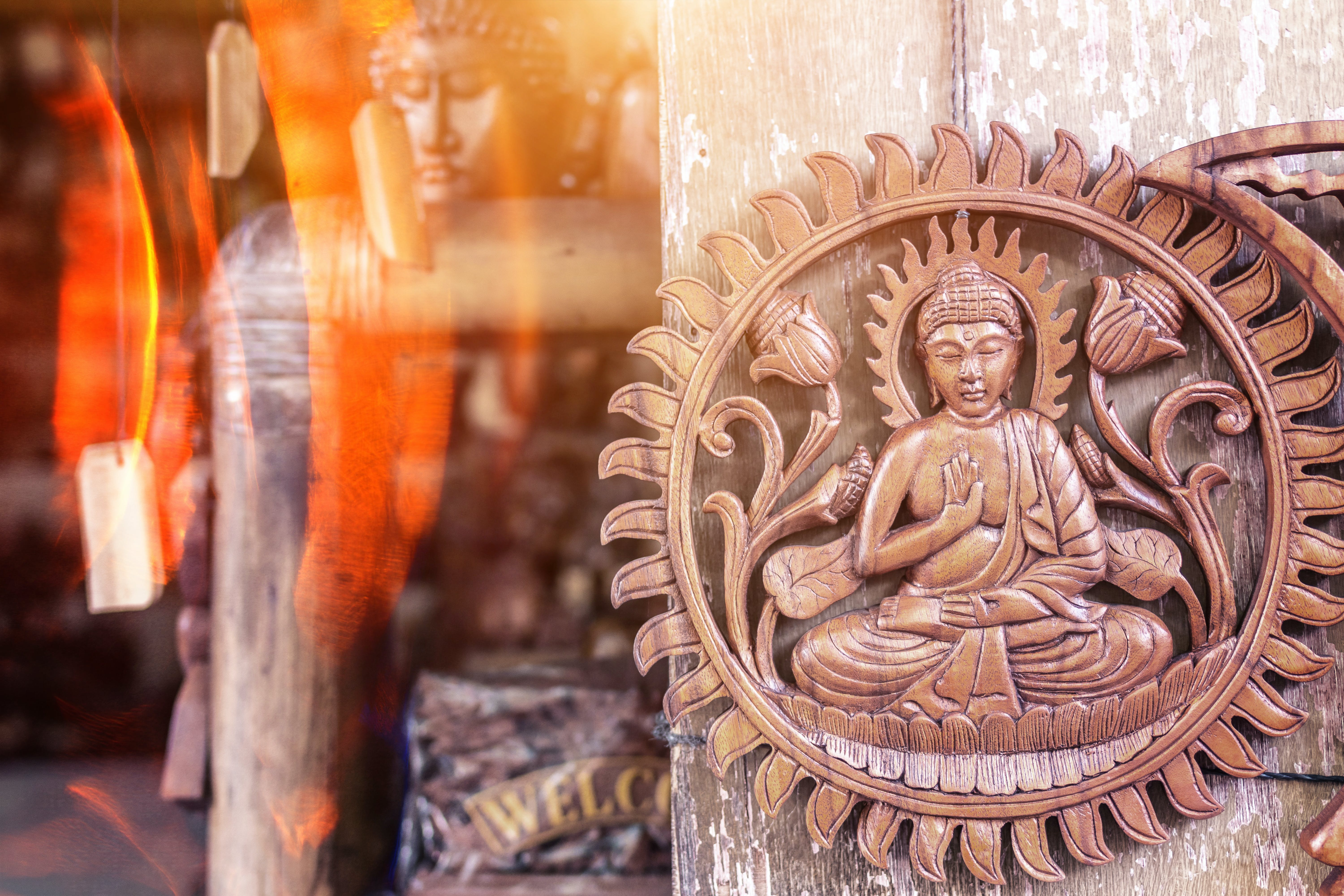 Buddha Brown Wooden Wall Decor Hanging on Gray Surface