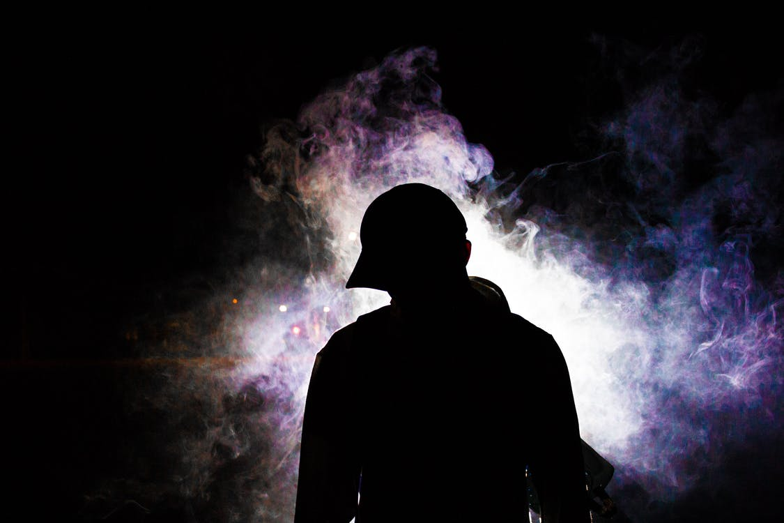 Silhouette Photography of Smoke Behind Person