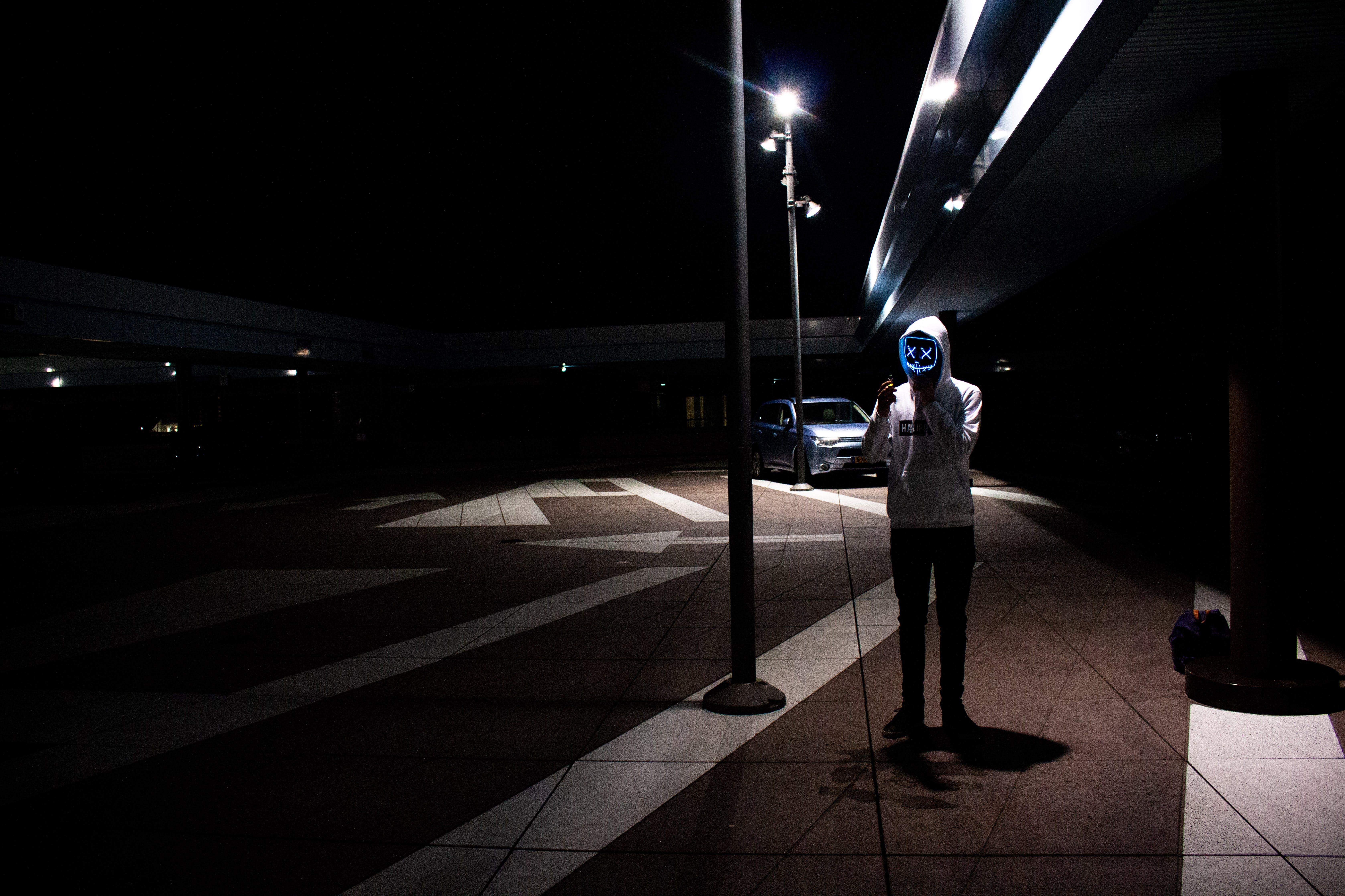 Man Wearing Hoodie Near Post