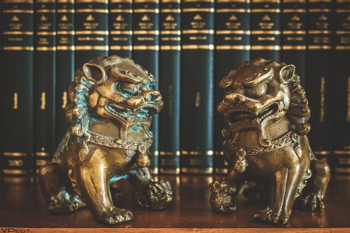 Two Brown Chinese Guardian Lions Figures on Table Top