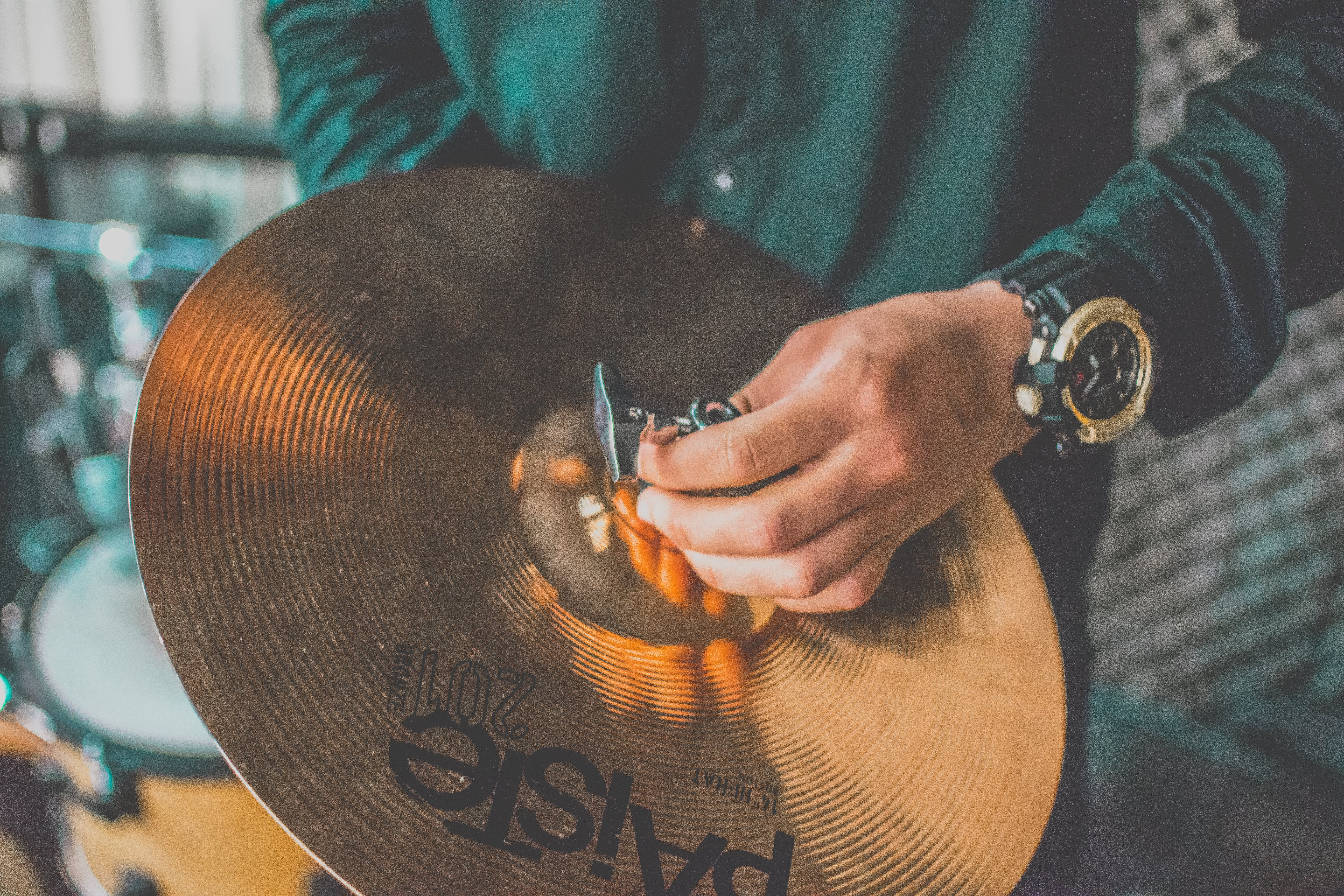 Person Holding Paiste Cymbal