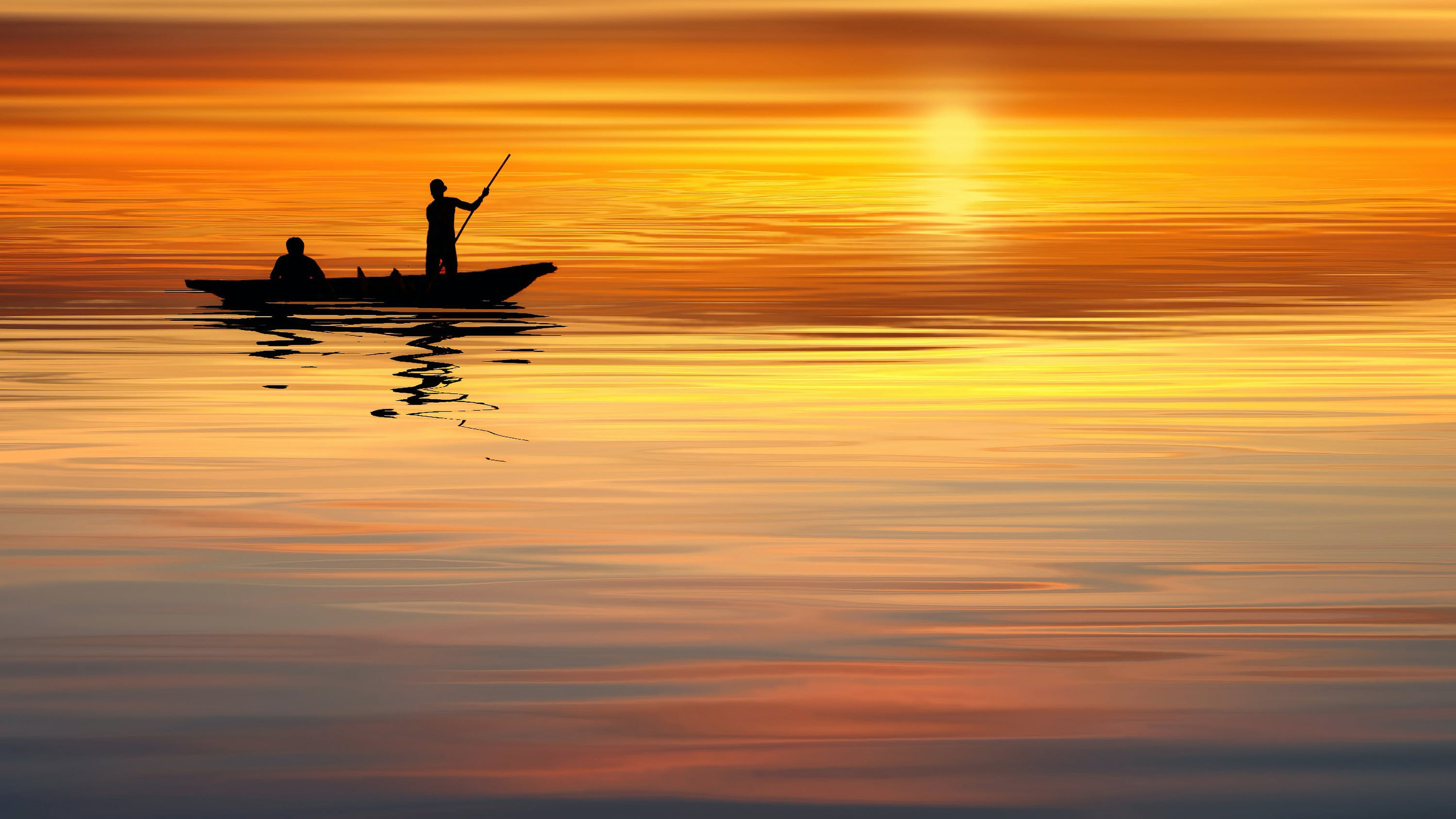 Silhouette Boat and Man Sailing on Ocean