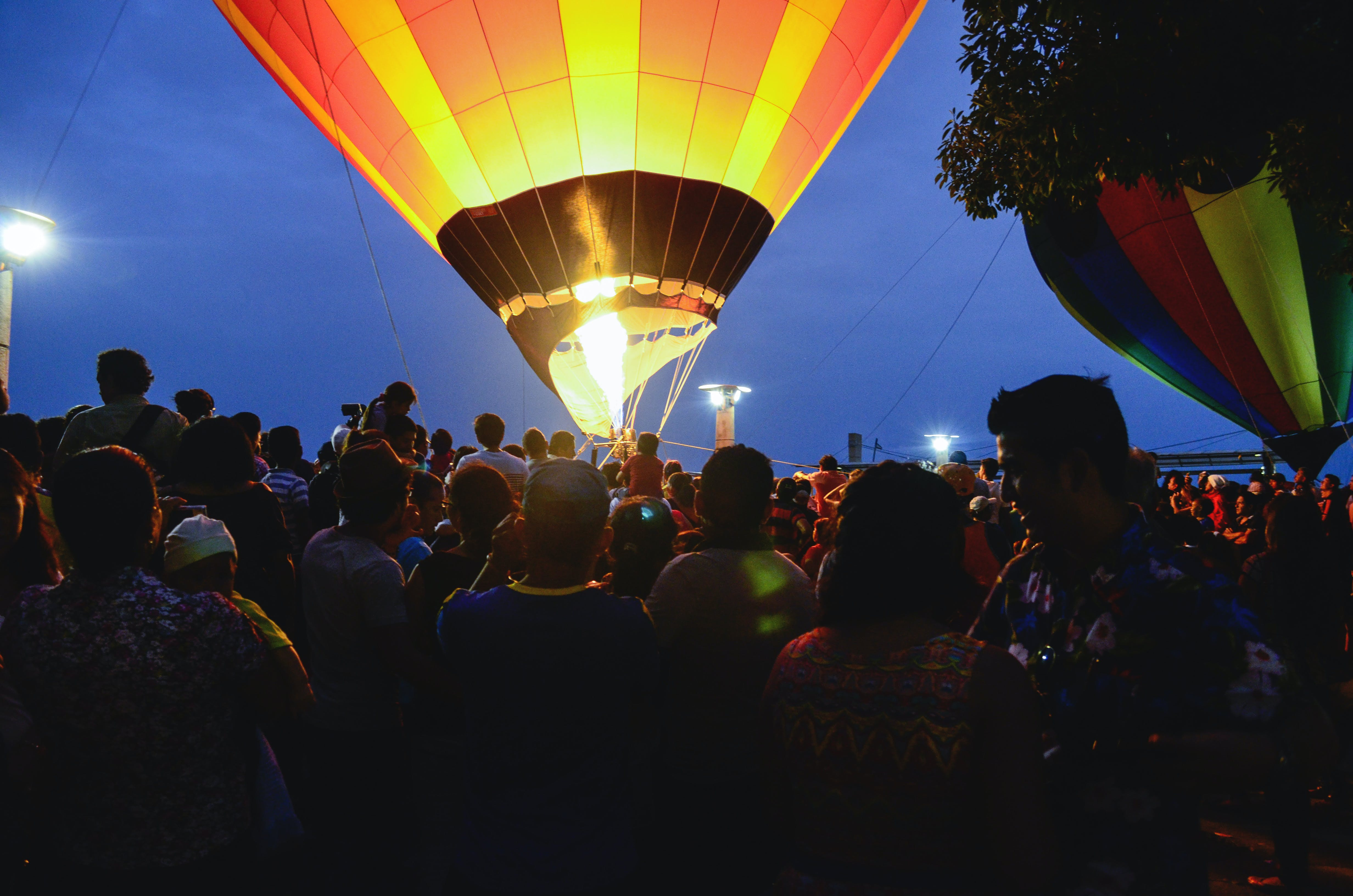 Group of People Gathered Near Hot Air Balloon