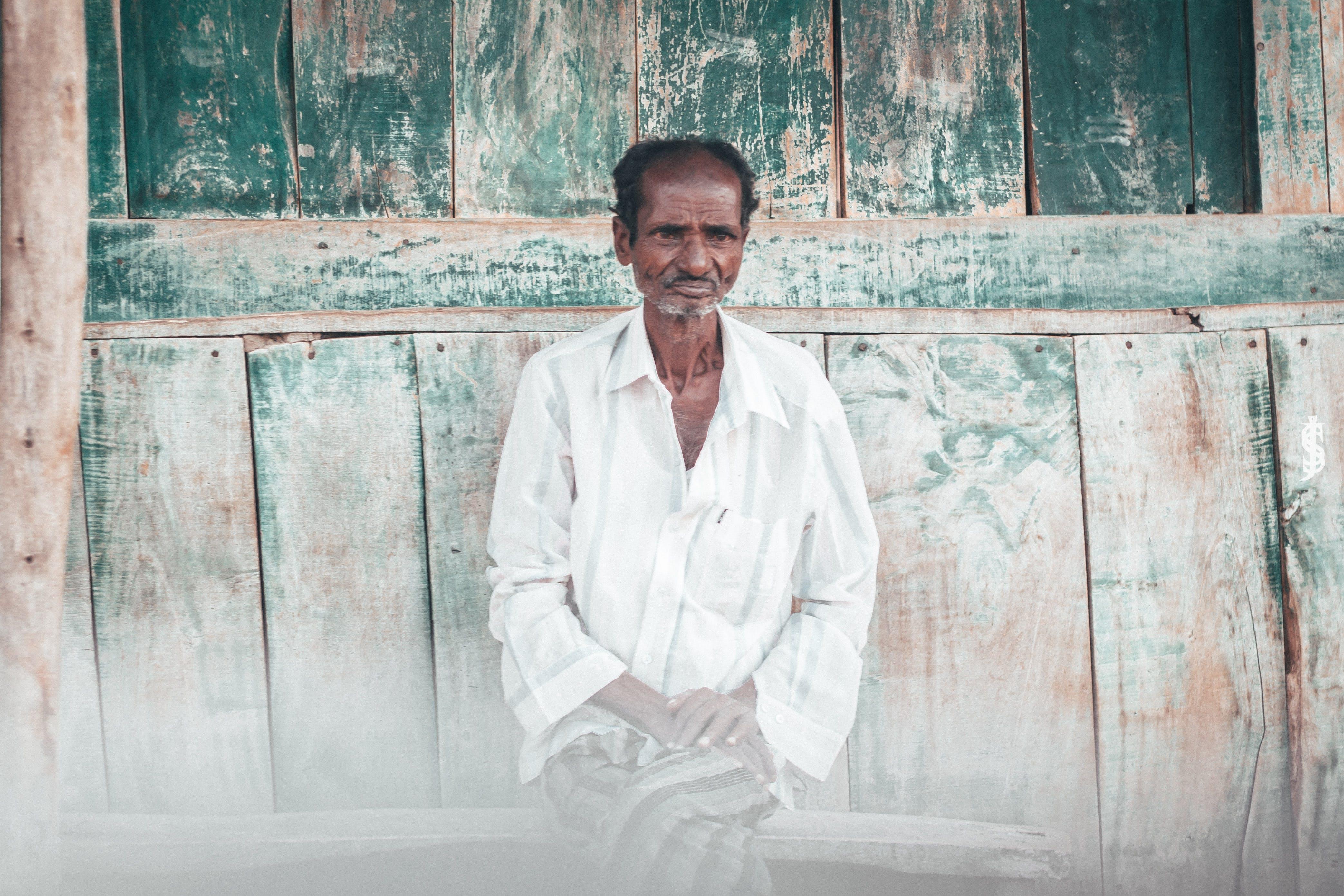 Man With Cross-legged Sitting on Bench