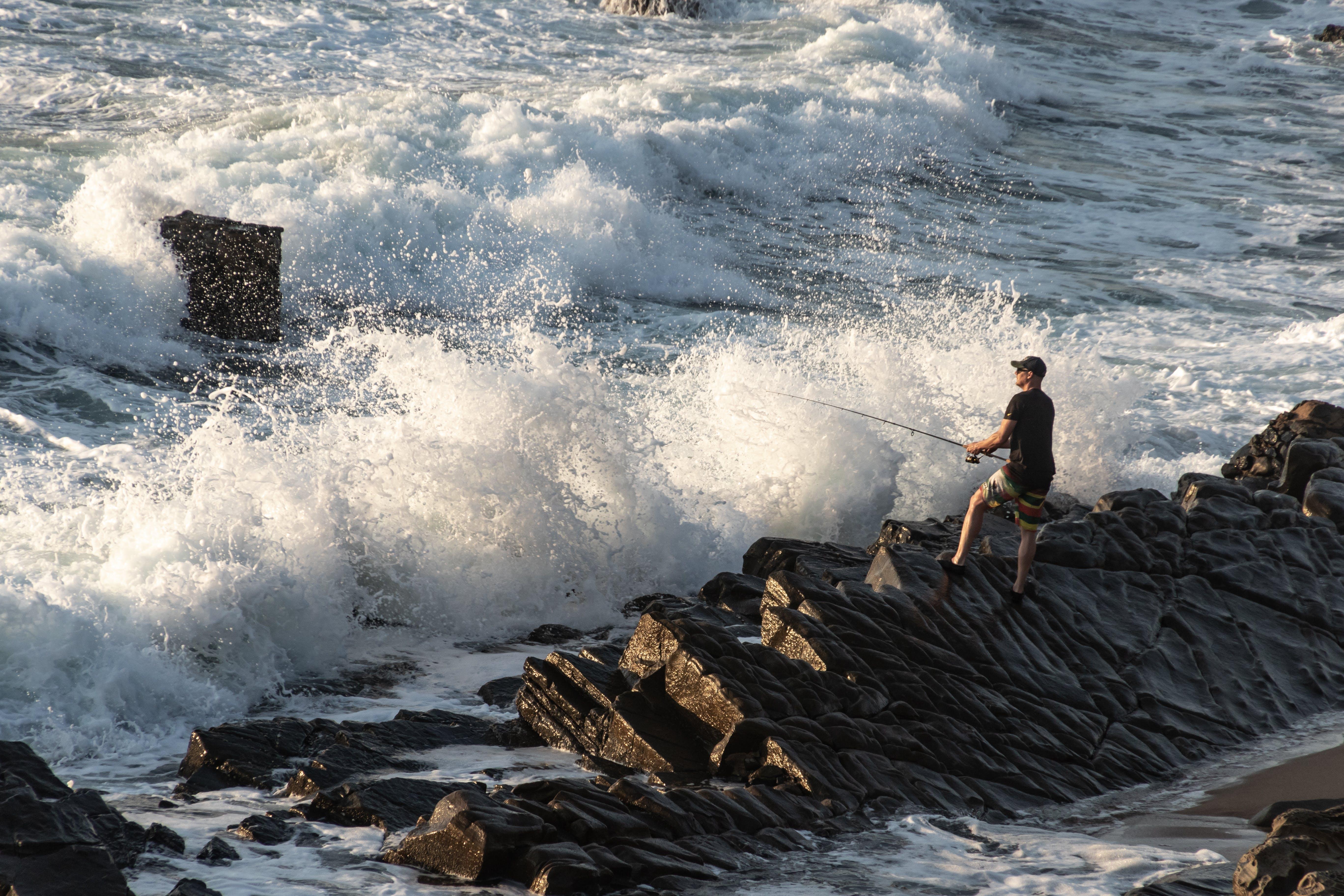 Man Standing Near Shore