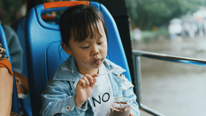 Close-Up Photo of Child Eating Ice Cream