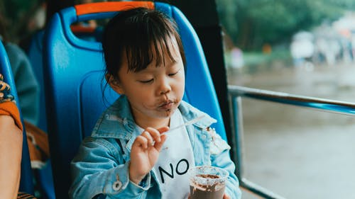 Close-Up Photo of Child Eating Ice Cream