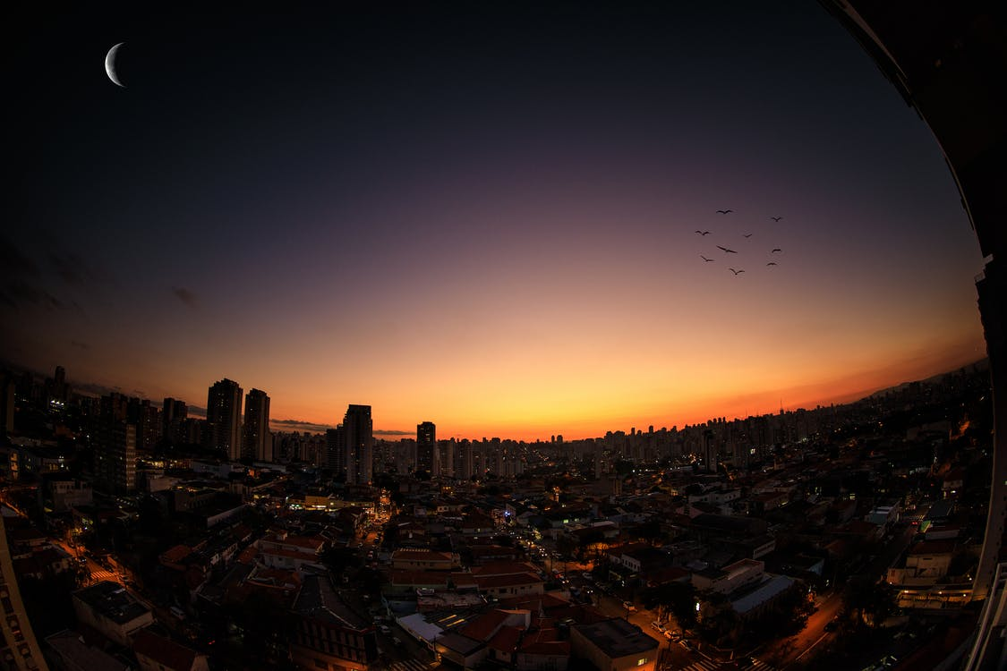 Scenic View of City During Sunset