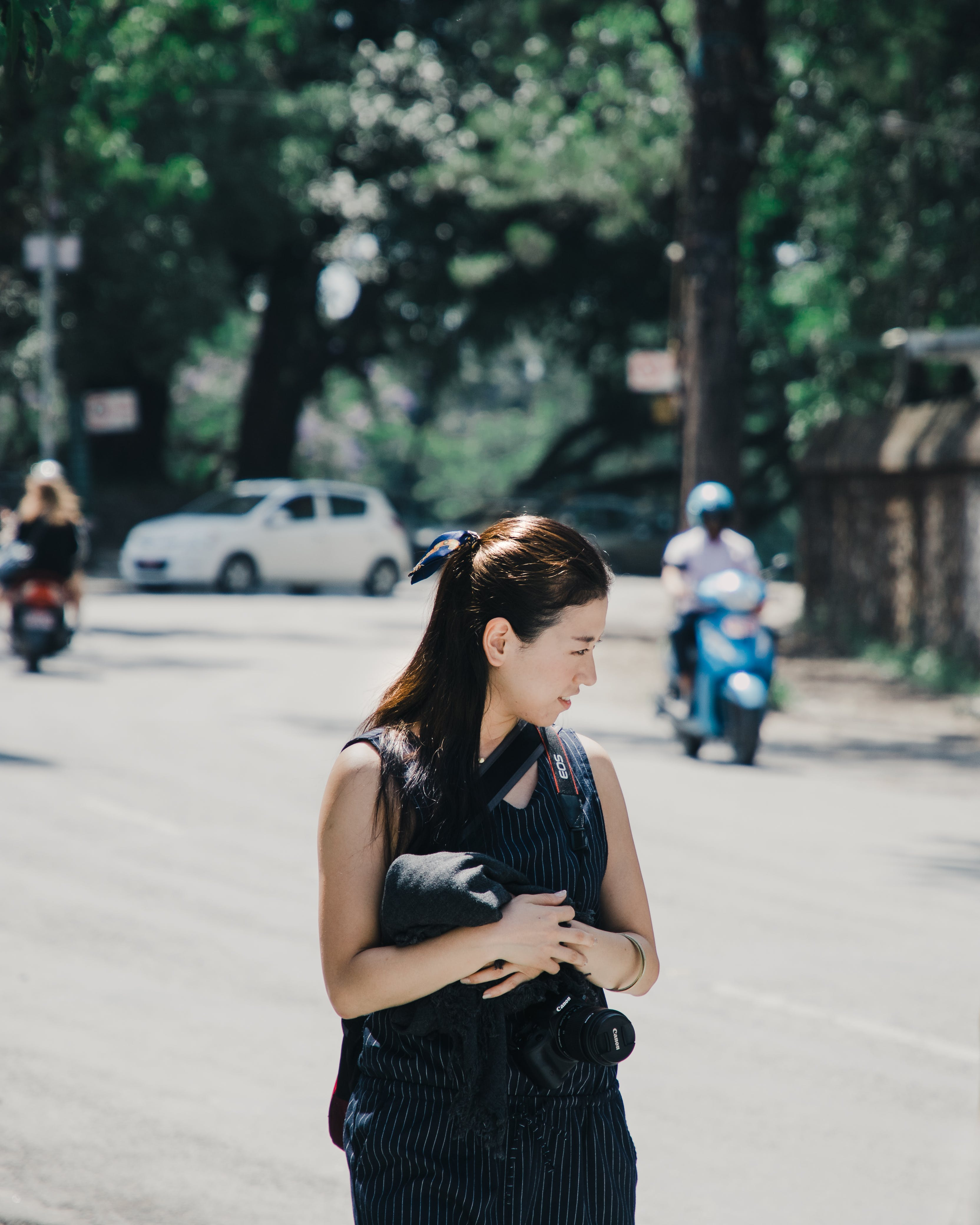 Shallow Focus Photography of Woman in Black Sleeveless Top