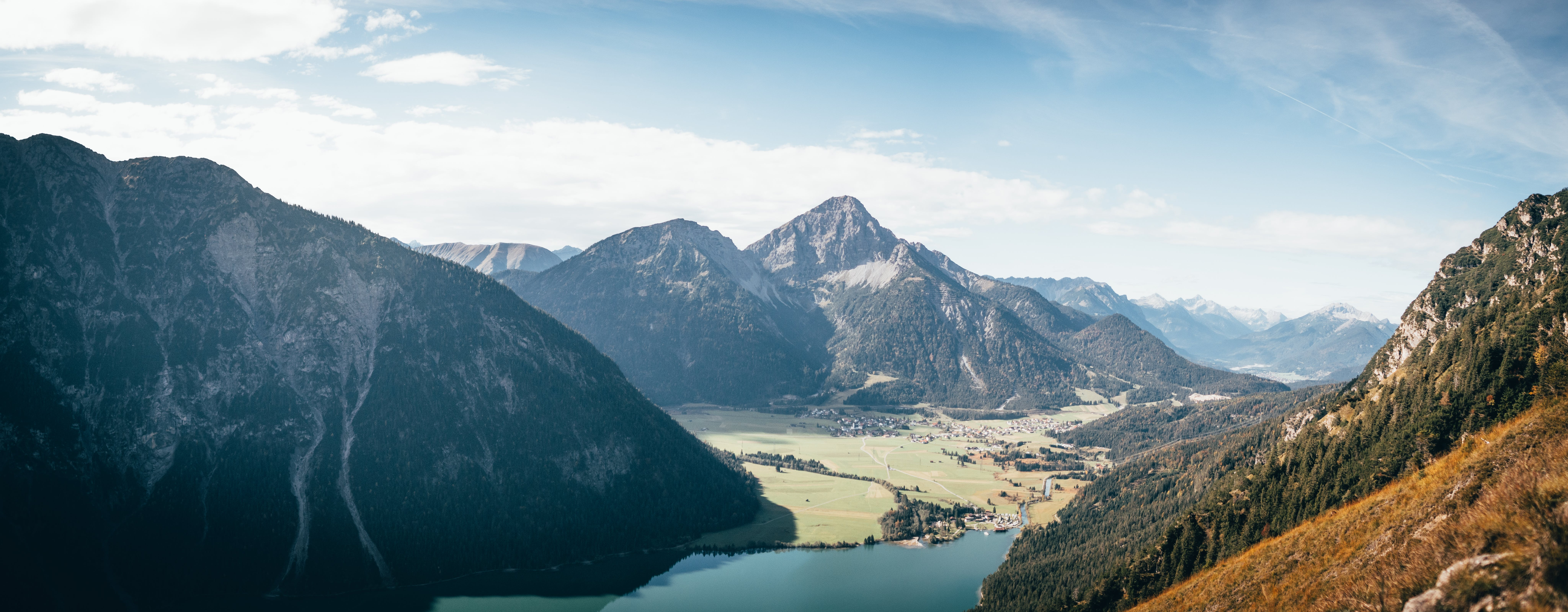 Aerial Photography of Mountain and Body of Water