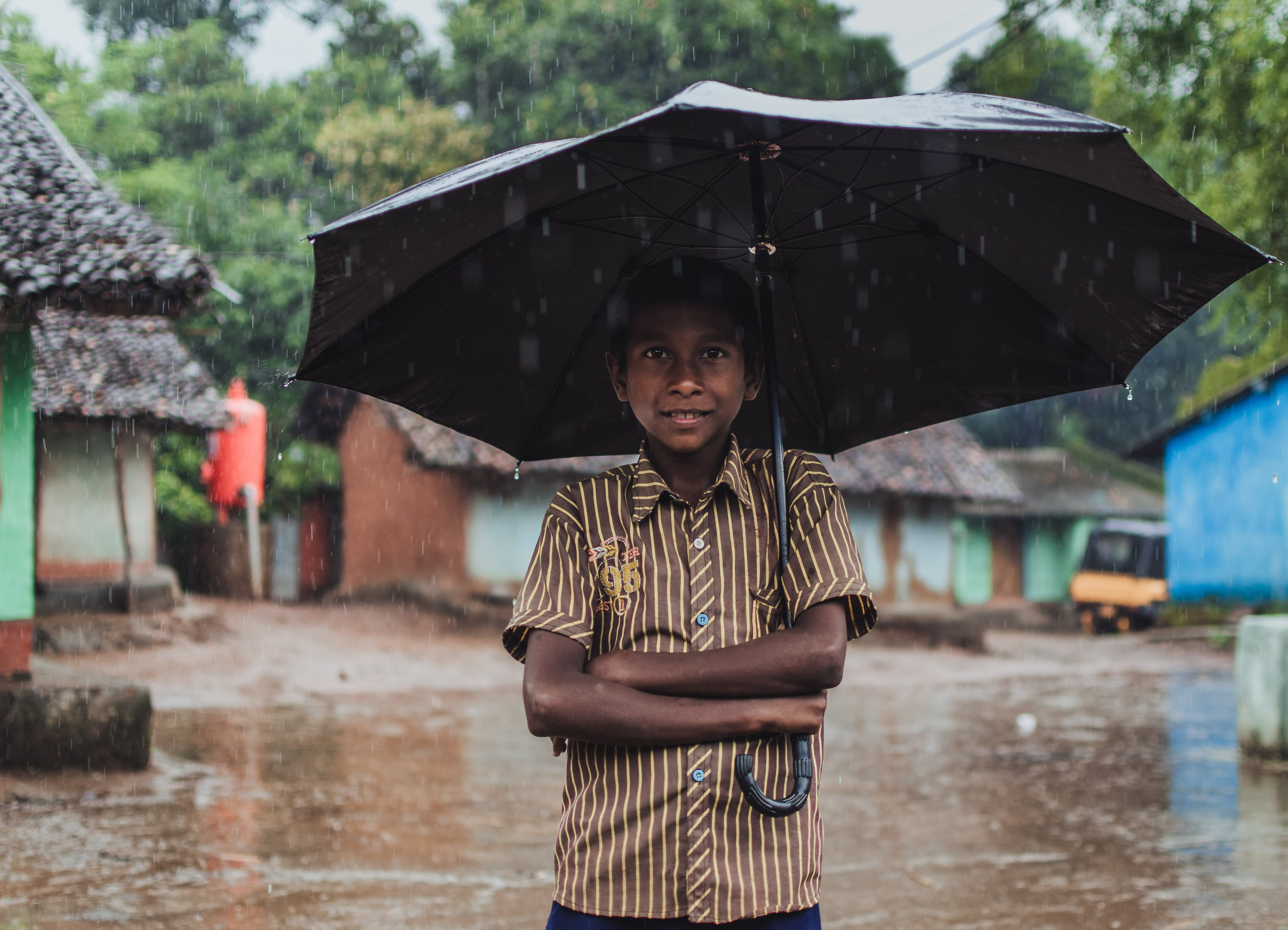 Boy Holding Black Umbrella