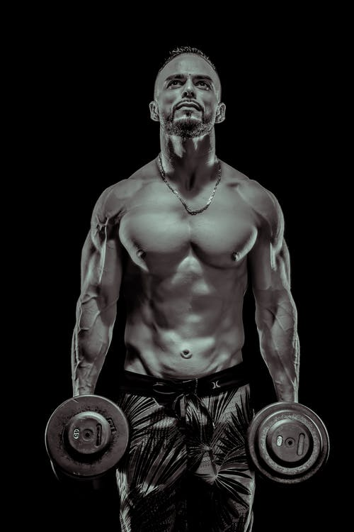 Man Carrying Dumbbells