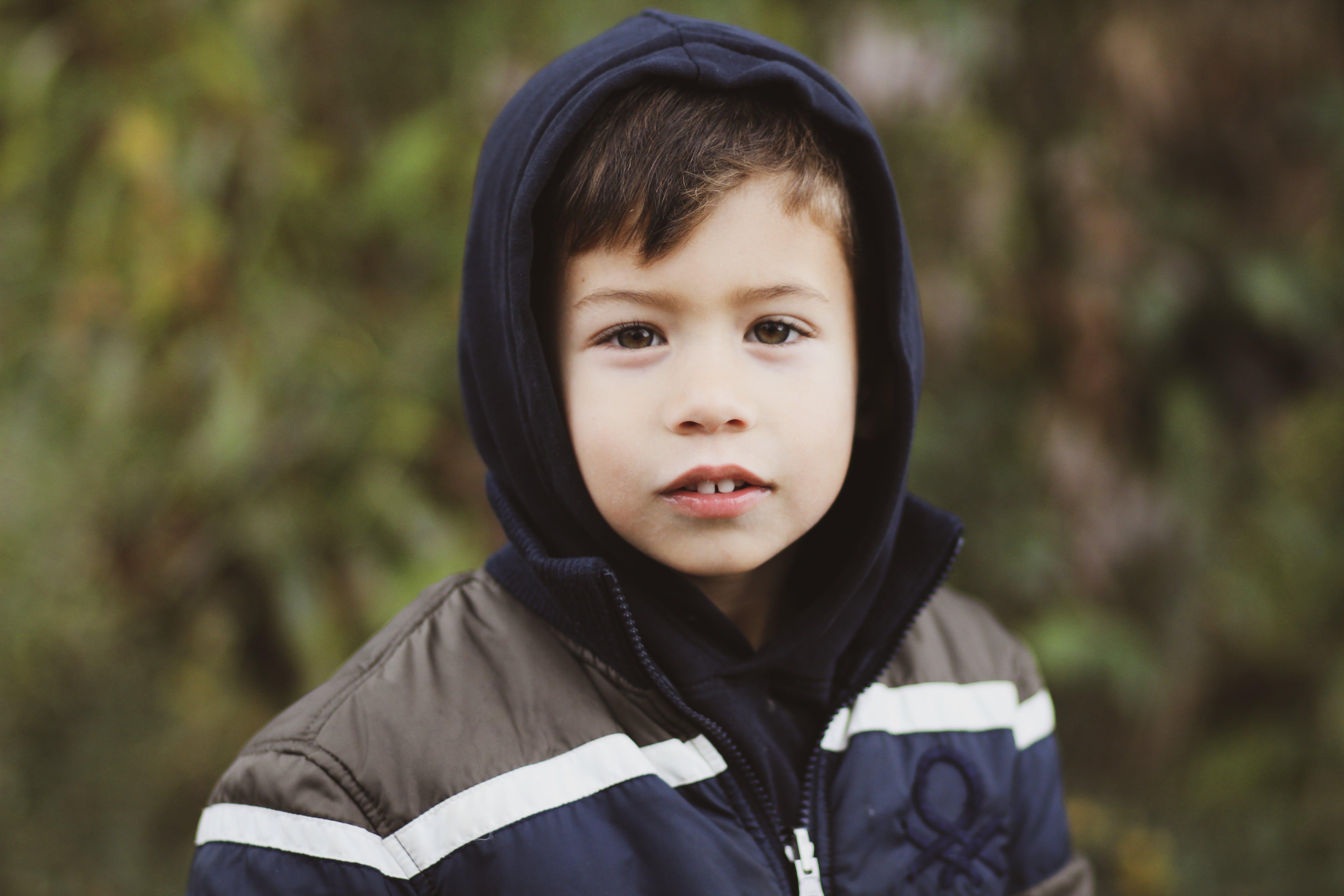 Boy Wearing Blue and Gray Full-zip Hoodie