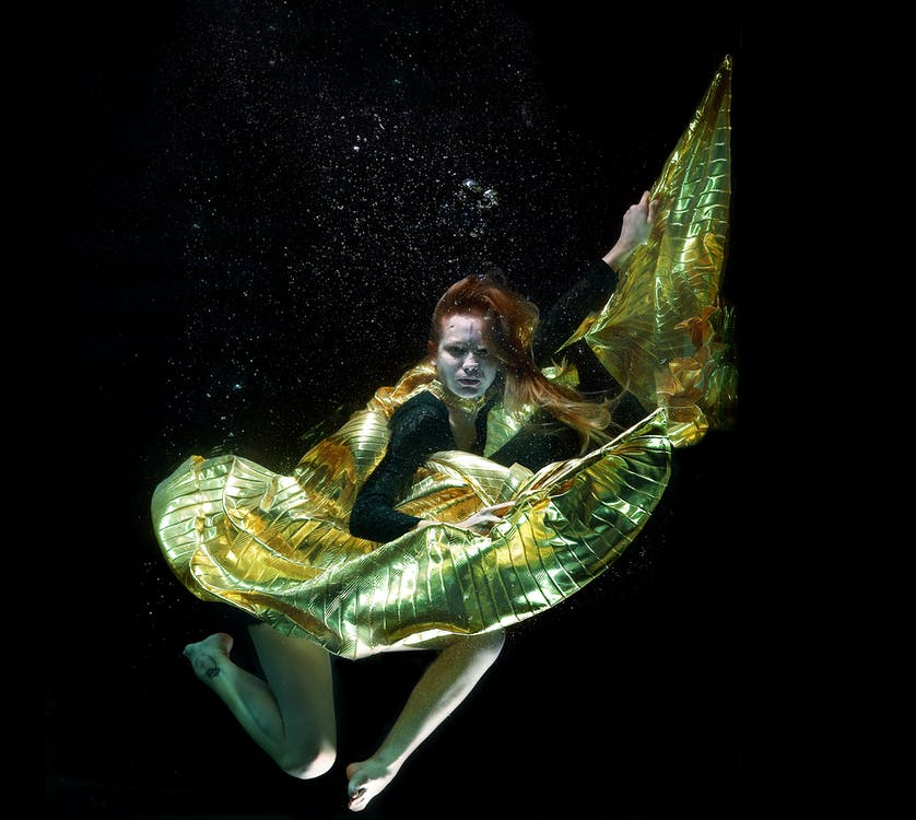 Underwater Photo of Woman Wearing Green and Black Dress