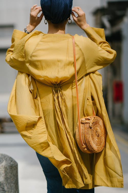 Woman Wearing Yellow Long-sleeved Dress Standing on Road