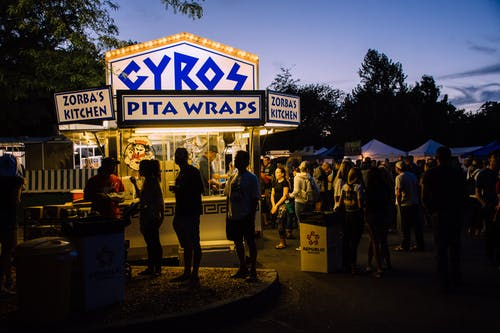 Group of People Near Gyros Pita Wraps Food Stall