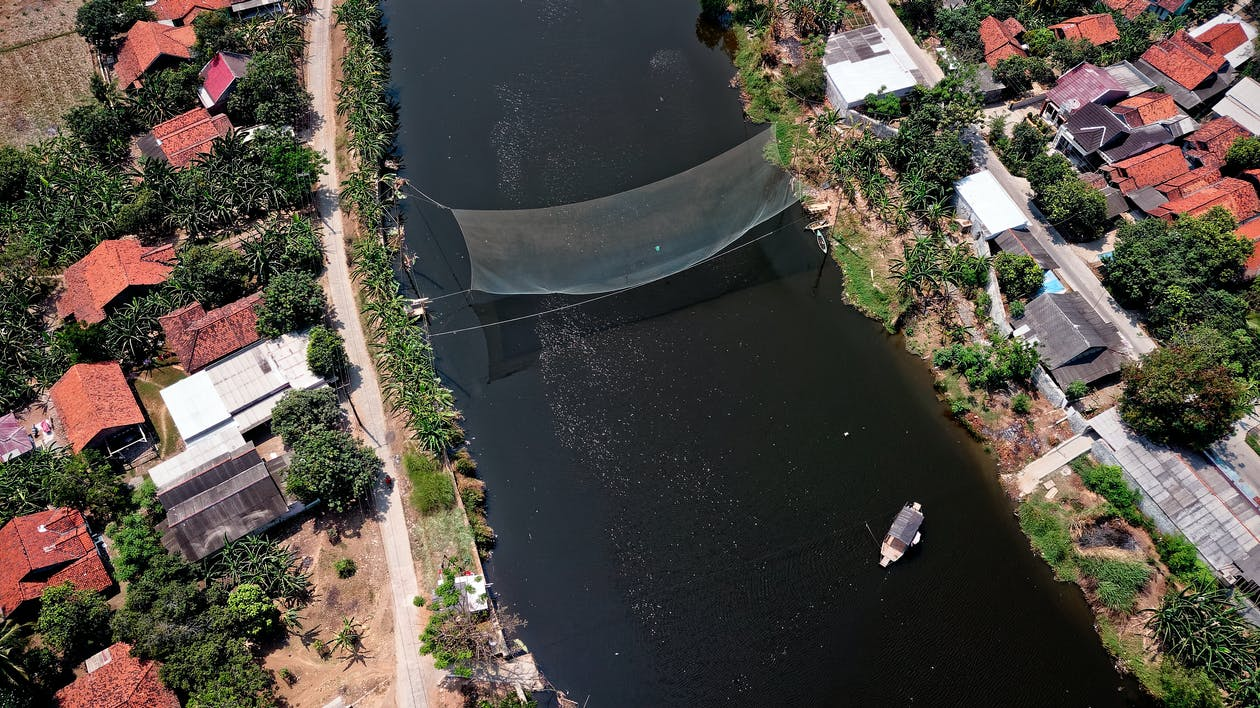 Bird's Eye View Photography of River in Between Houses