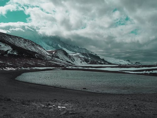 Gratis stockfoto met bergen, bevroren, bewolkt, donkere wolken