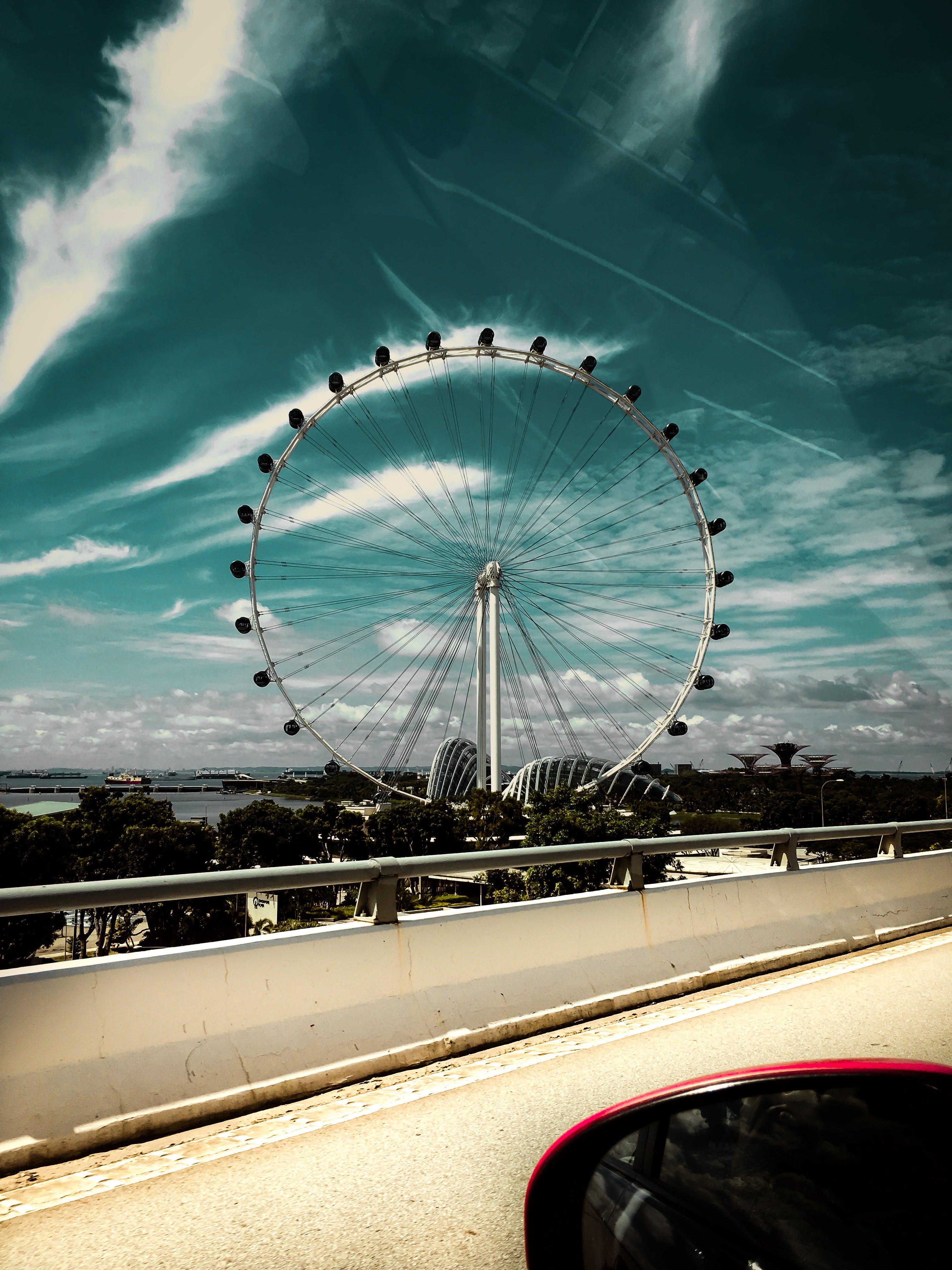 Photo of a Ferris Wheel Near Bridge