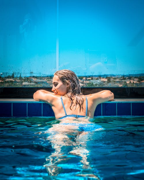 Photograph of Woman in Pool
