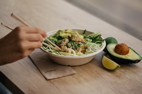 Vegetable Salad With Avocado and Lime in White Bowl