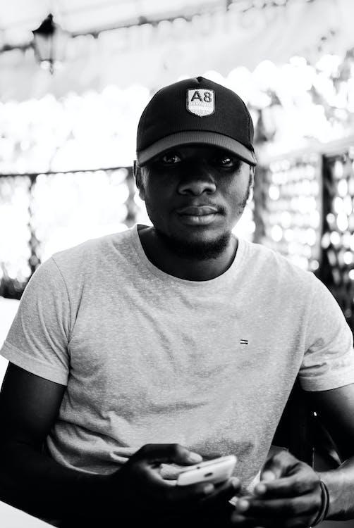 Monochrome Photo of Man Wearing Cap