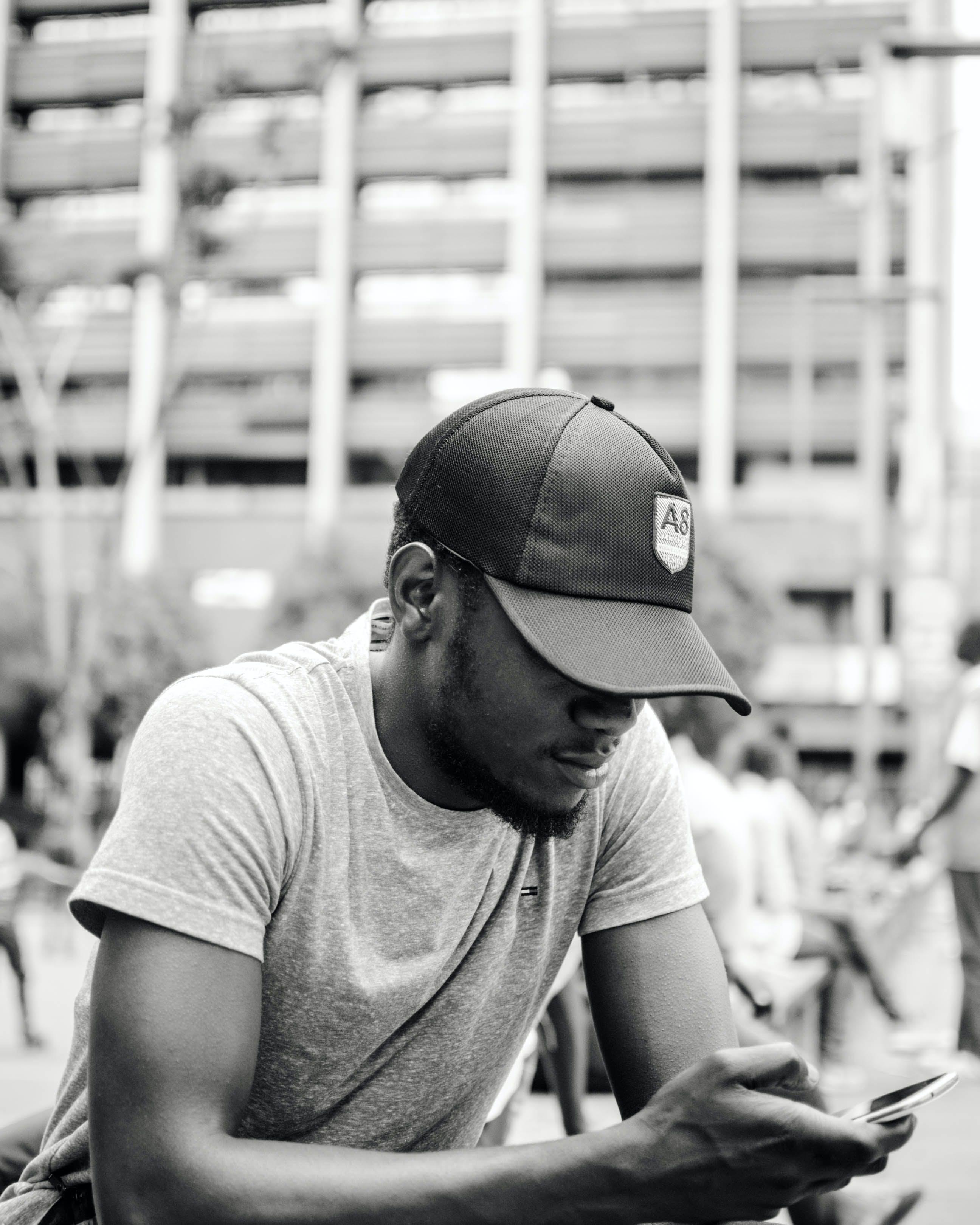 Monochrome Photo of Man Texting