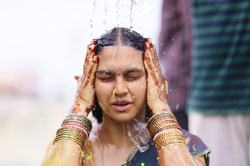 Woman Taking Shower While Wearing Sari Dress