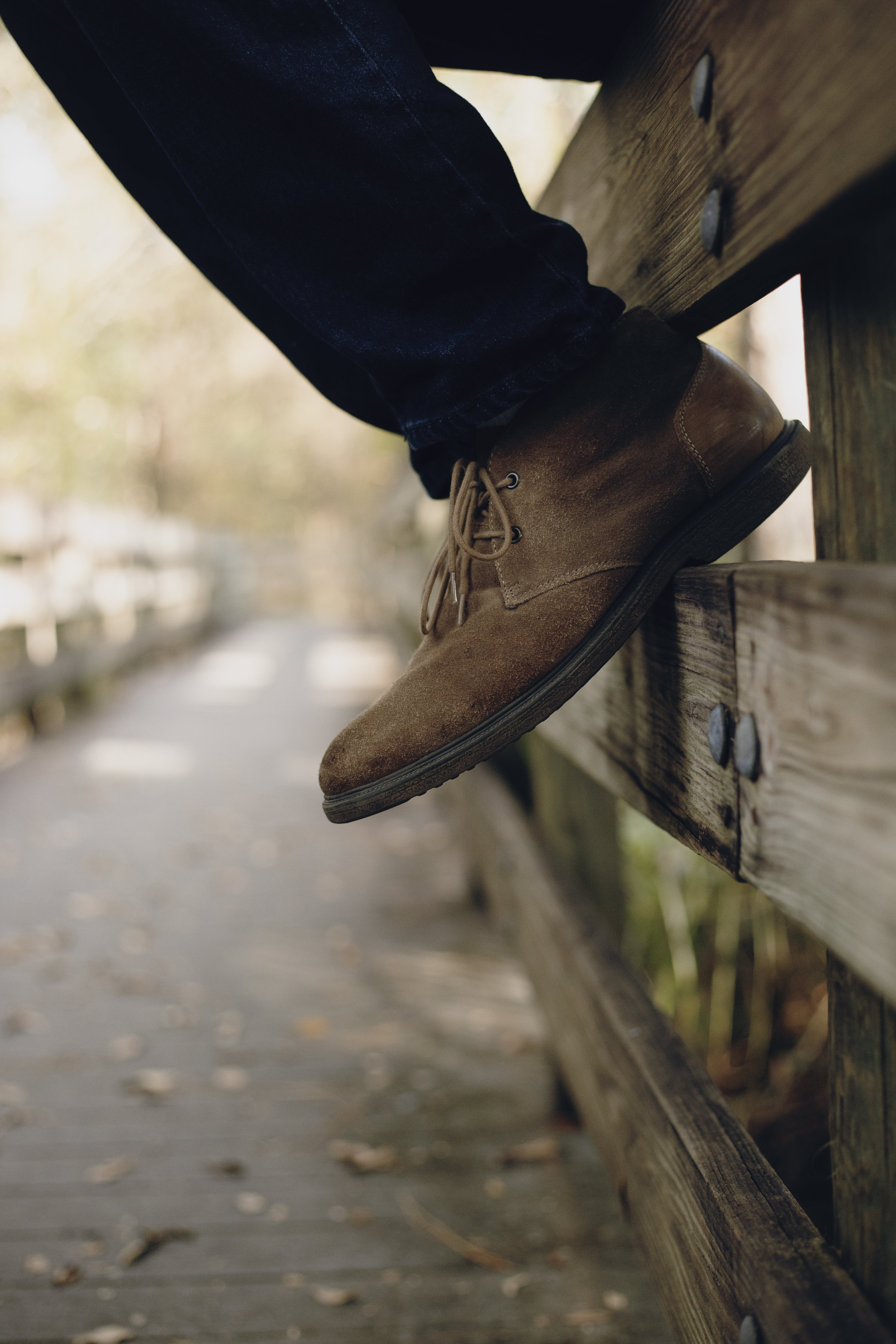 Selective Focus Photo of Brown Boots