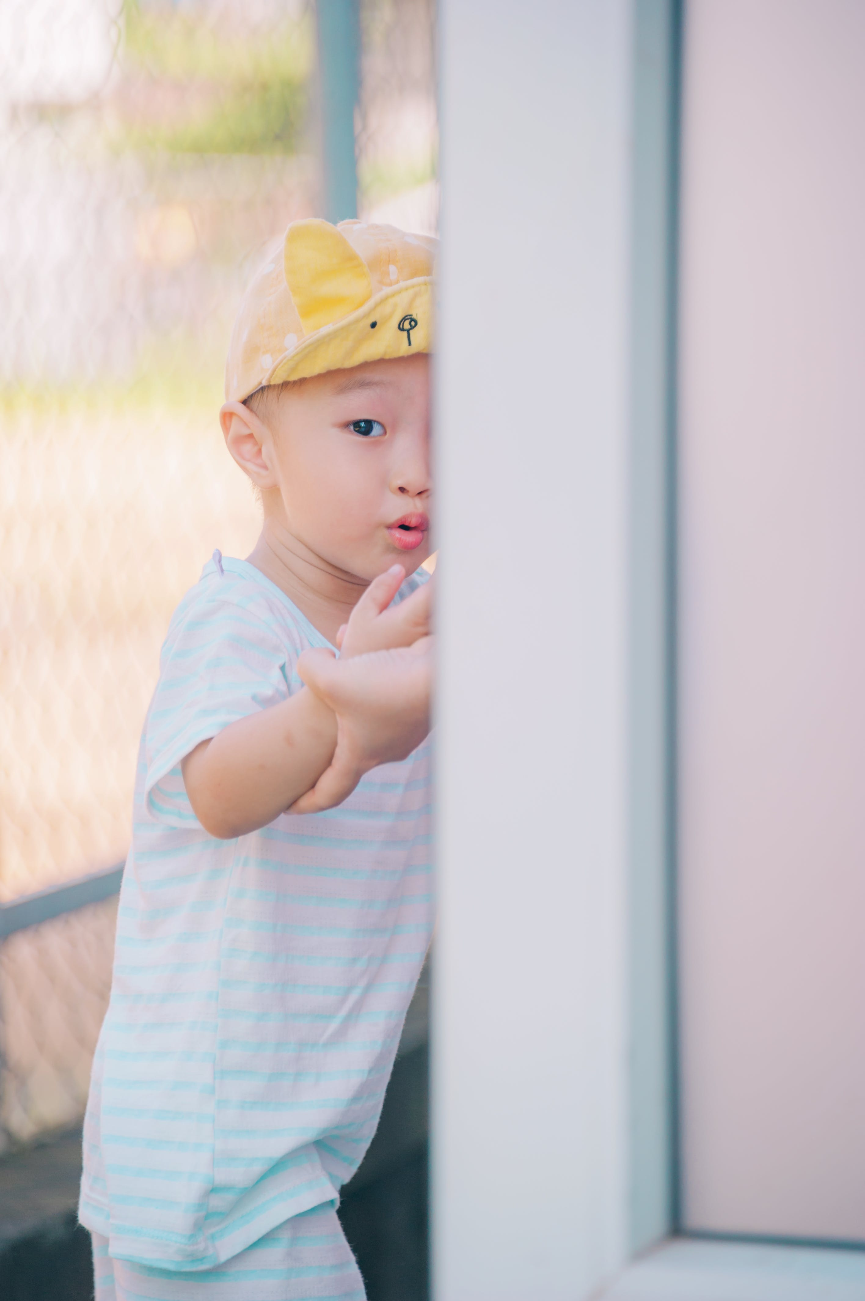 Selective Focus Photo of Child Wearing Cap