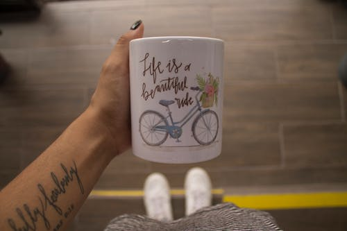 Free stock photo of bicycle, coffee, cup, hand