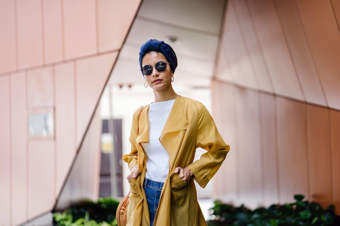 Stylish Woman Posing in Yellow Coat