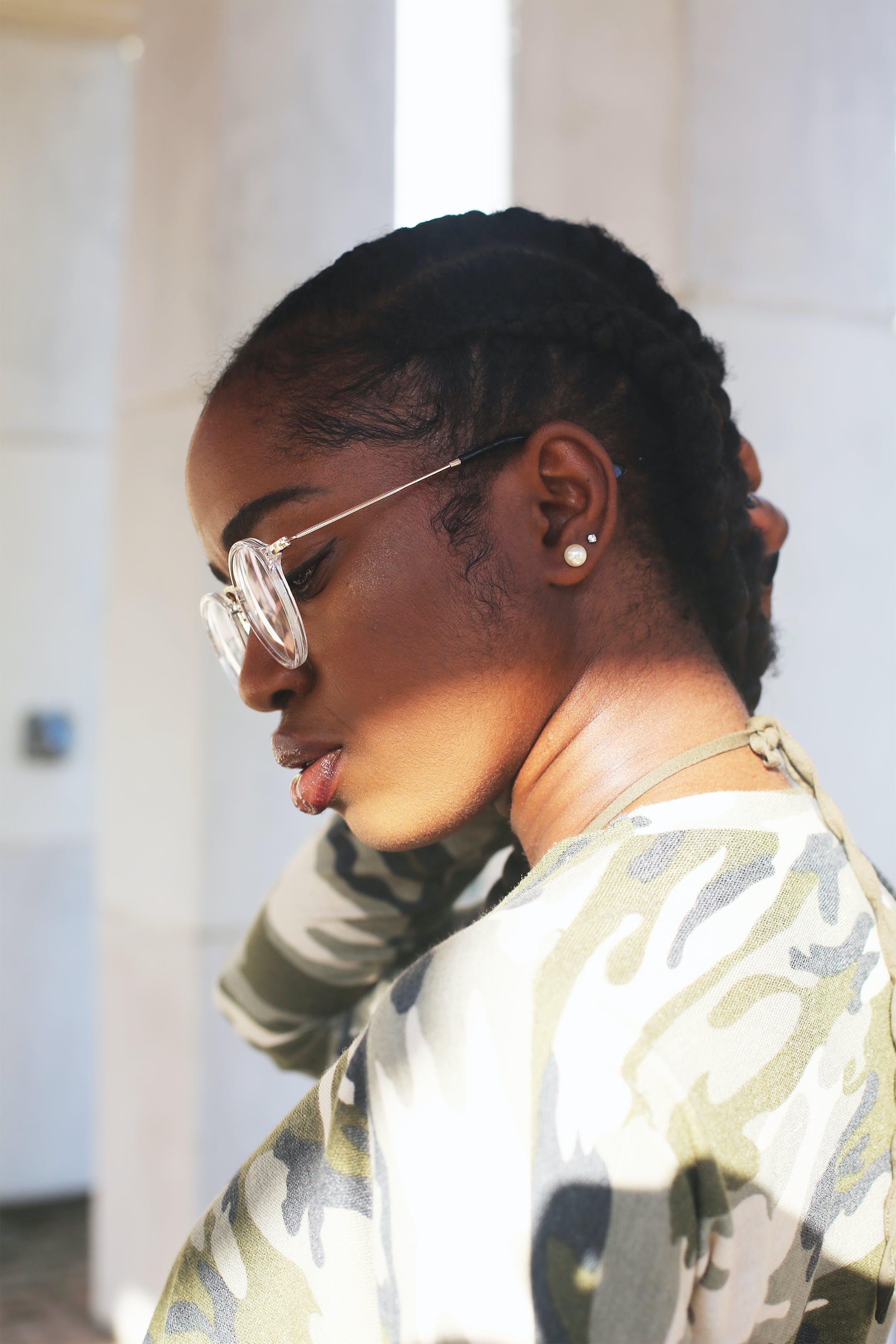 Photo of Woman Wearing Eyeglasses