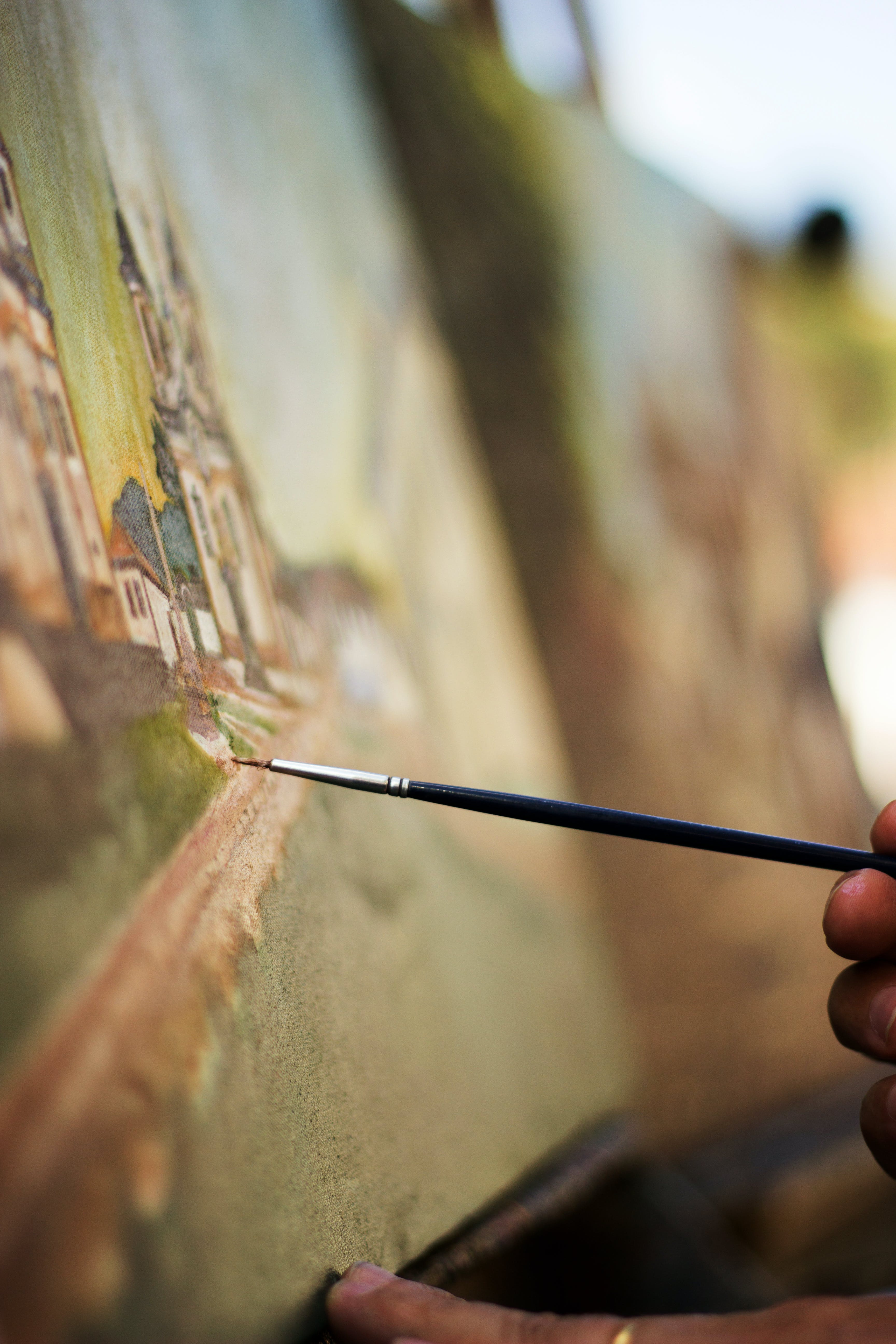 Closeup Photo of Person Holding Paintbrush