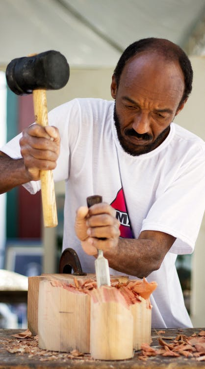 Man Holding Chisel and Mallet
