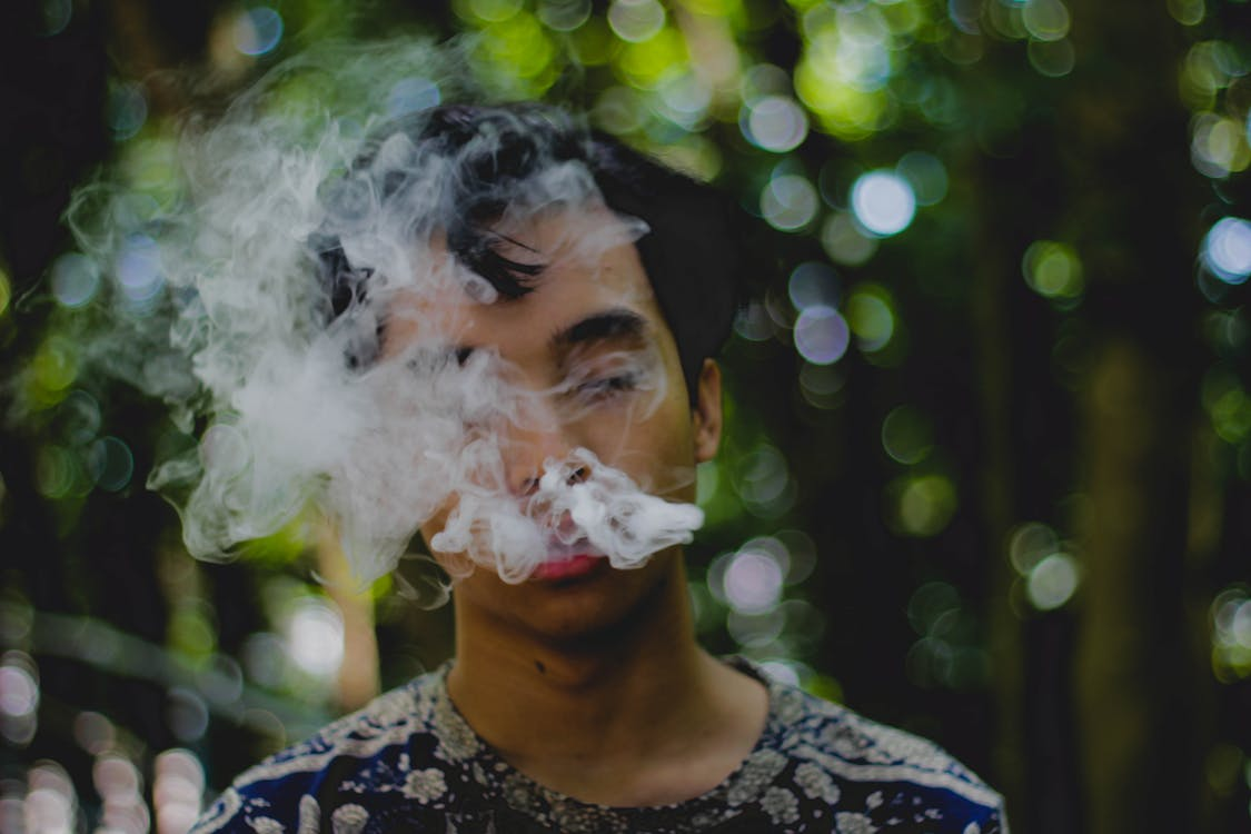 Person Exhaling Smoke