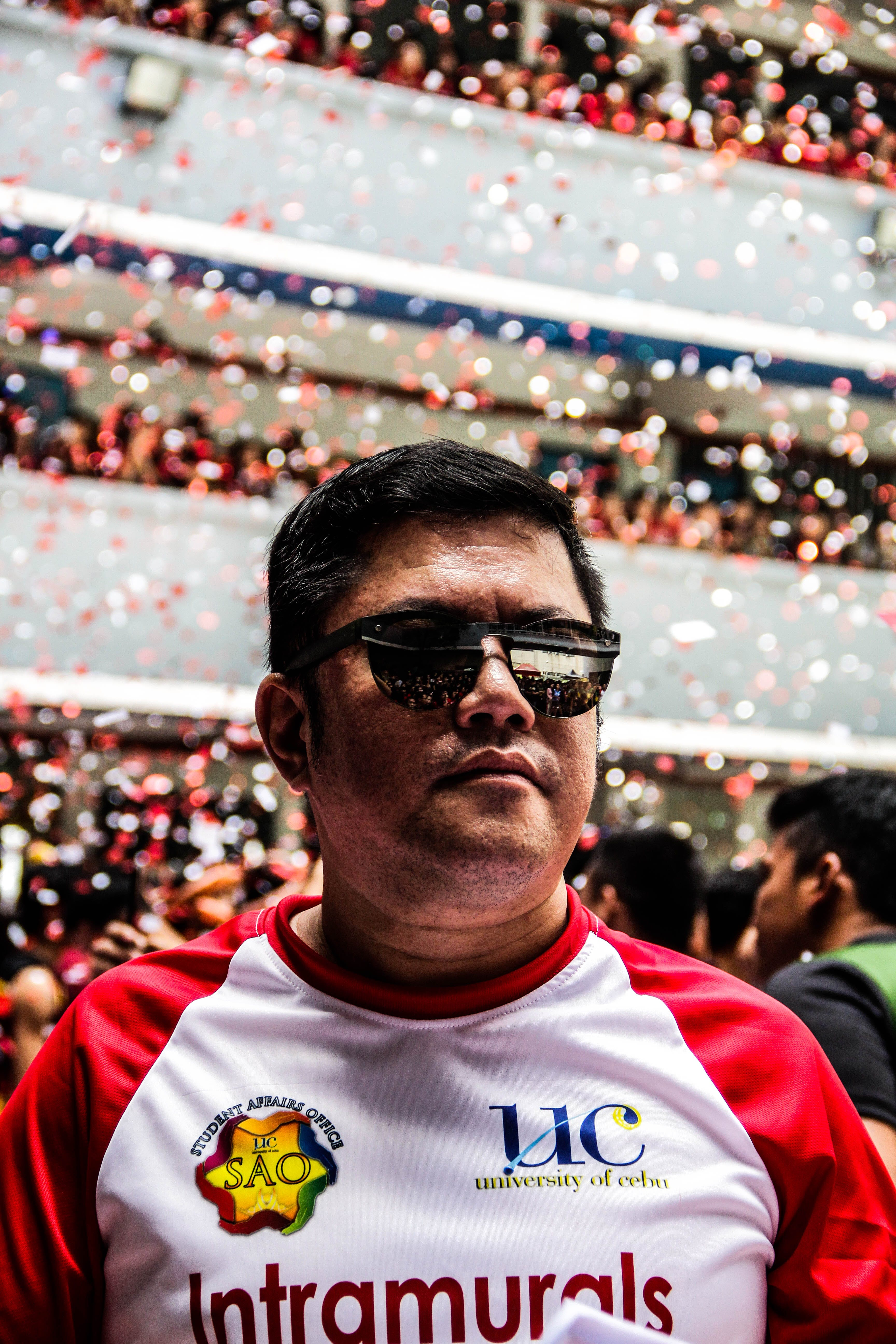 Man Wearing Red and White Top and Black Sunglasses